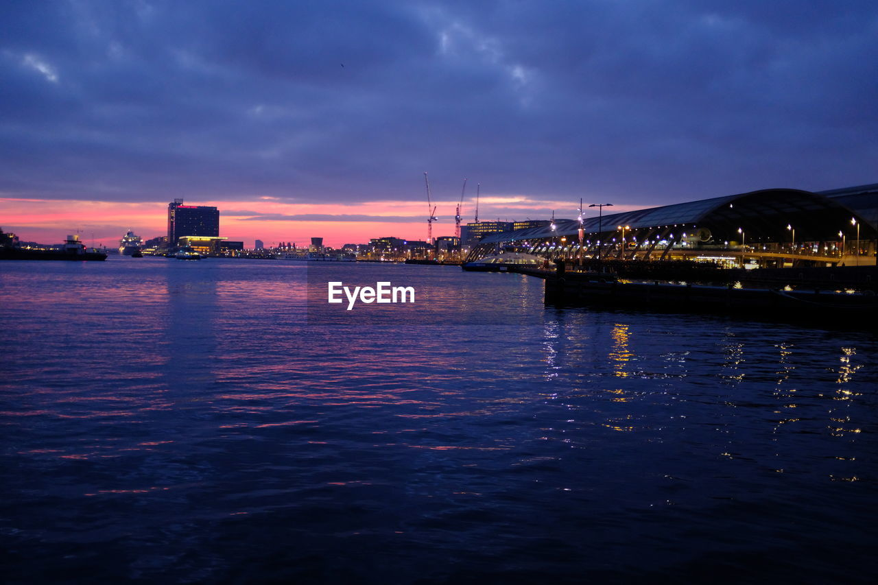 sky, water, cloud - sky, waterfront, illuminated, architecture, built structure, sunset, nature, sea, no people, building exterior, reflection, city, beauty in nature, scenics - nature, outdoors, dusk