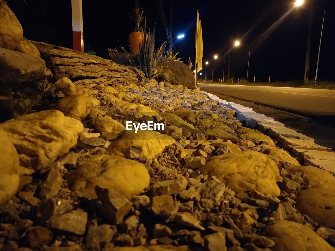 night, illuminated, no people, lighting equipment, street light, street, nature, winter, yellow, rock, selective focus, solid, snow, cold temperature, close-up, plant, glowing, rock - object, electricity, light - natural phenomenon