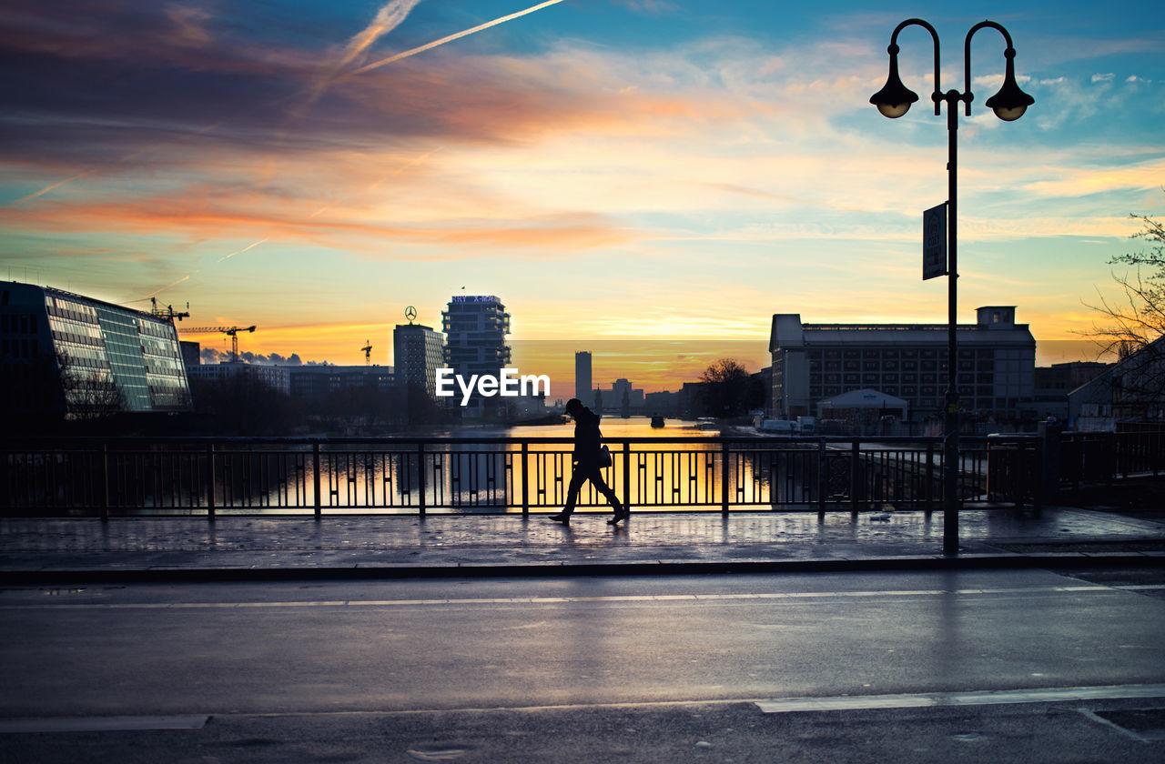 Silhouette Person Crossing Bridge