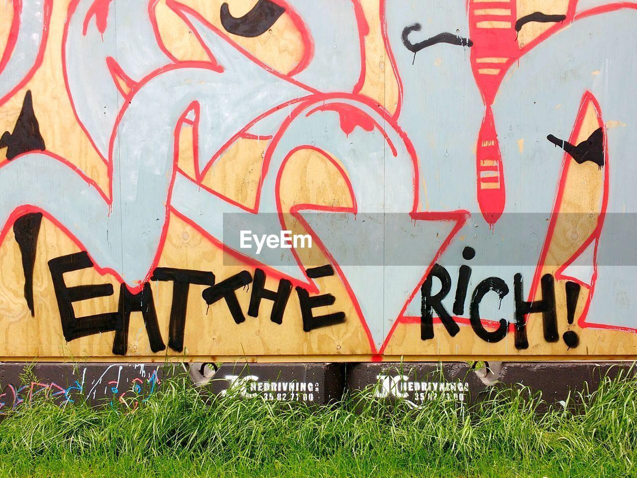 text, graffiti, communication, day, outdoors, no people, grass, architecture