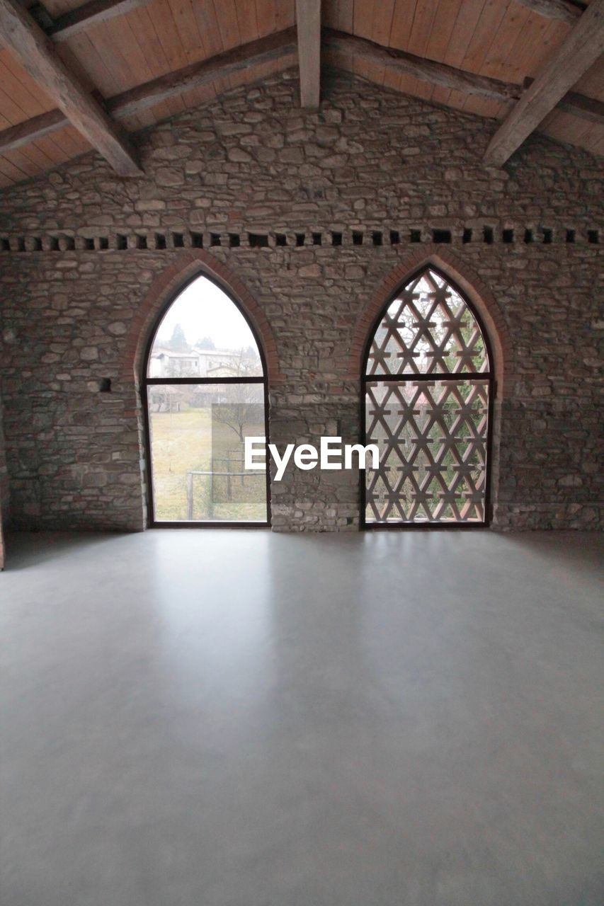 arch, architecture, indoors, built structure, history, window, day, no people