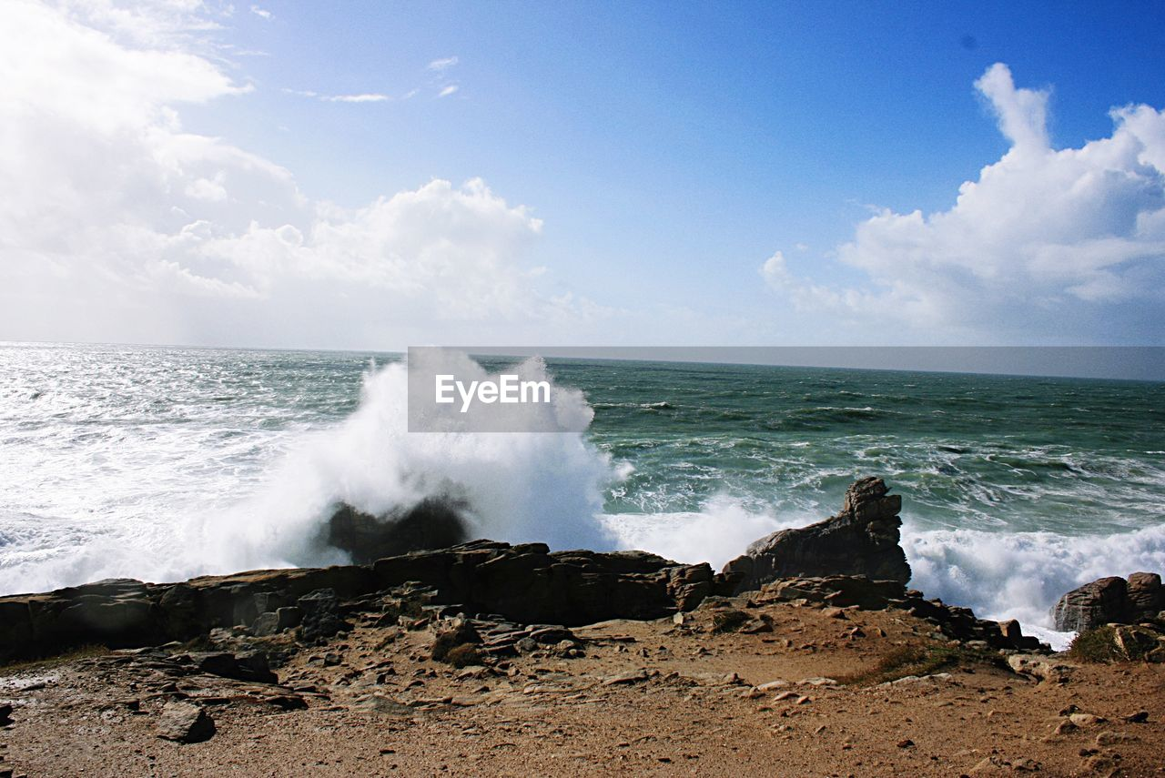 sea, water, sky, wave, beauty in nature, horizon, horizon over water, motion, power in nature, power, cloud - sky, scenics - nature, land, beach, nature, rock, no people, day, rock - object, breaking, outdoors, hitting