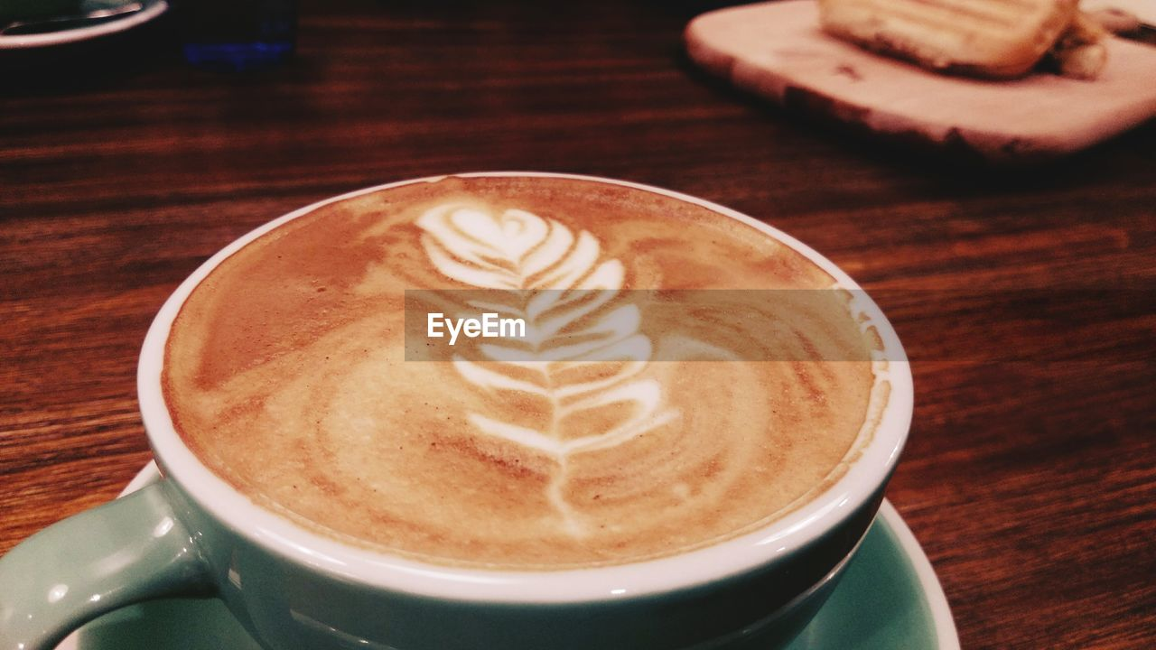 coffee cup, coffee - drink, frothy drink, drink, food and drink, refreshment, cappuccino, froth art, table, latte, indoors, freshness, high angle view, saucer, close-up, no people, day