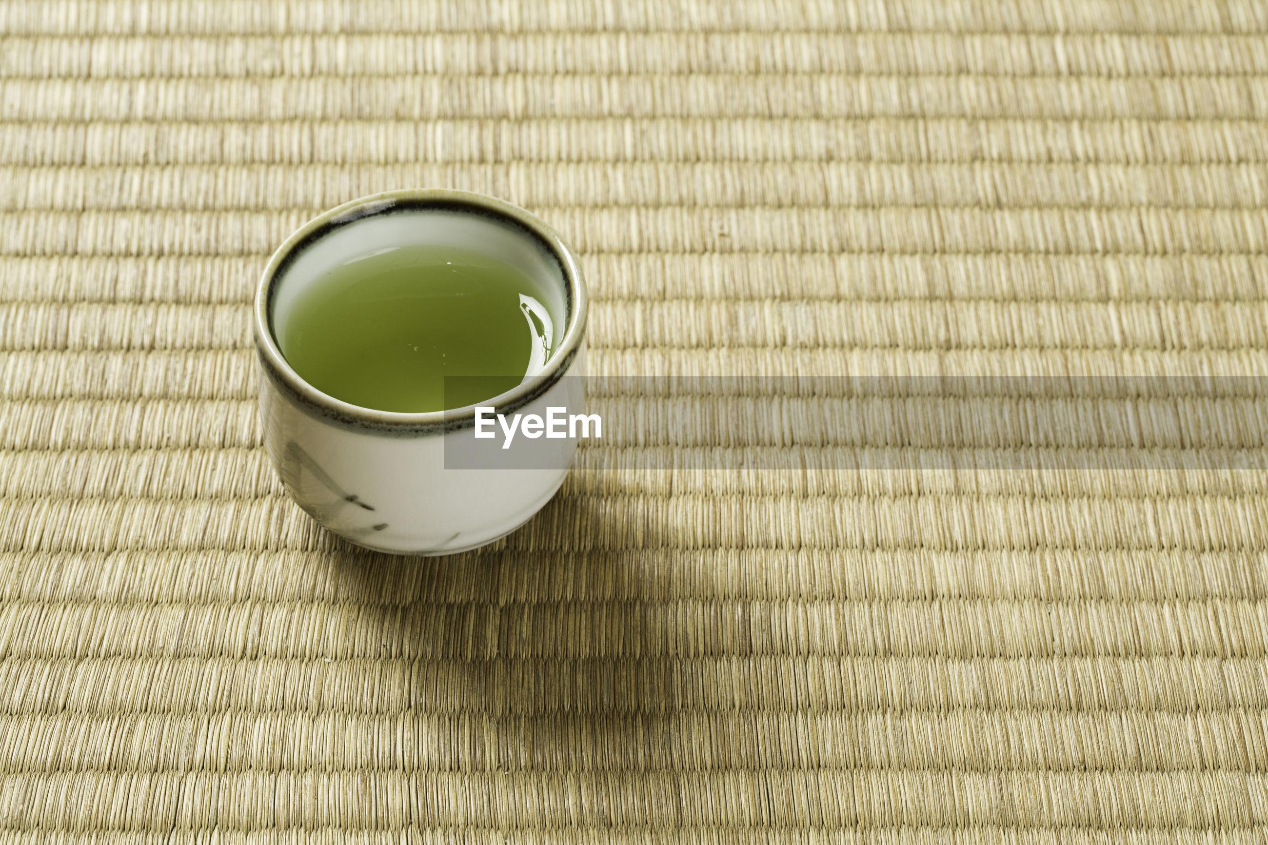 High angle view of matcha tea on place mat