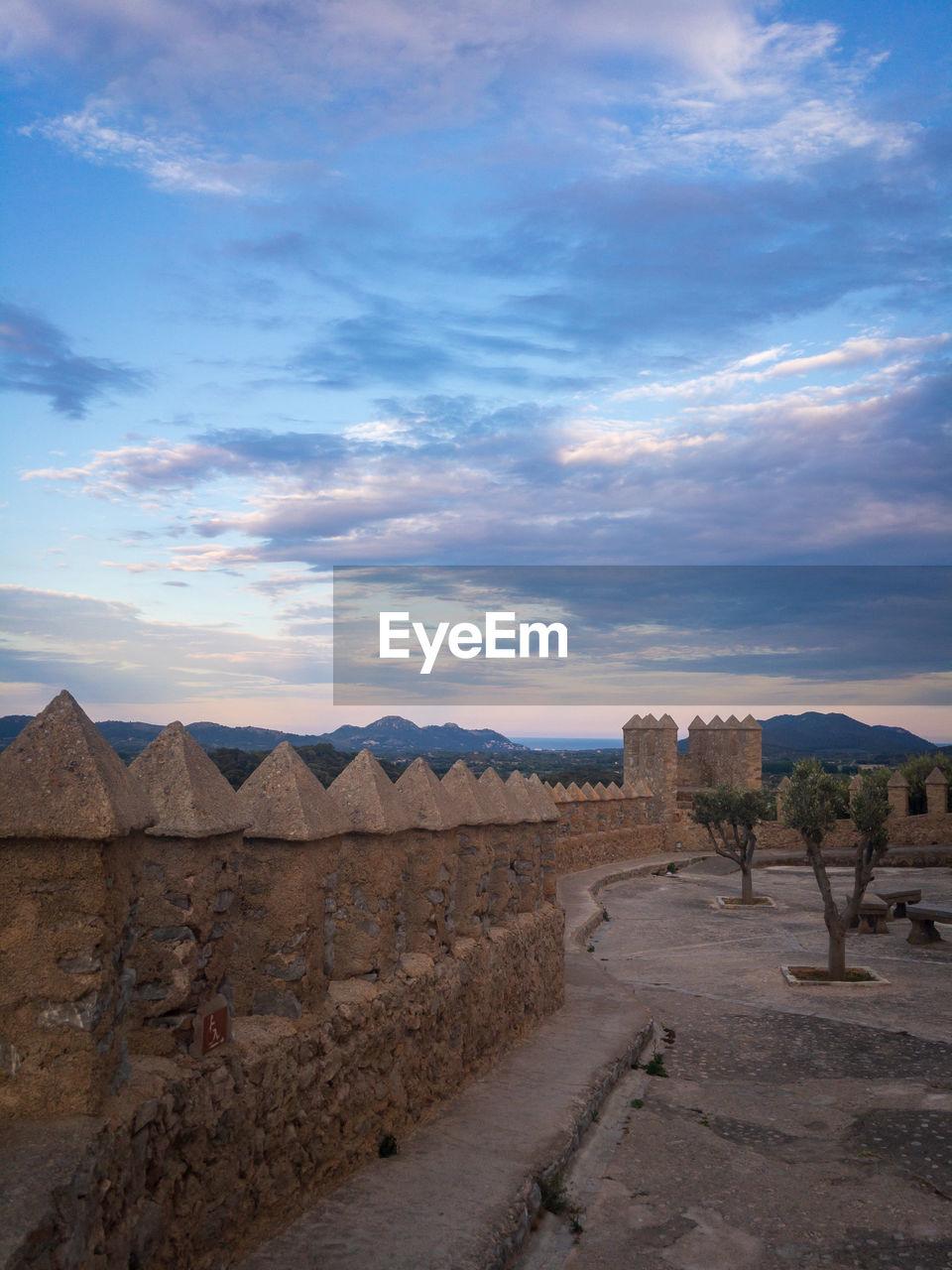 Defensive wall of castle sant salvador in the city of arta on balearic island majorca mallorc, spain