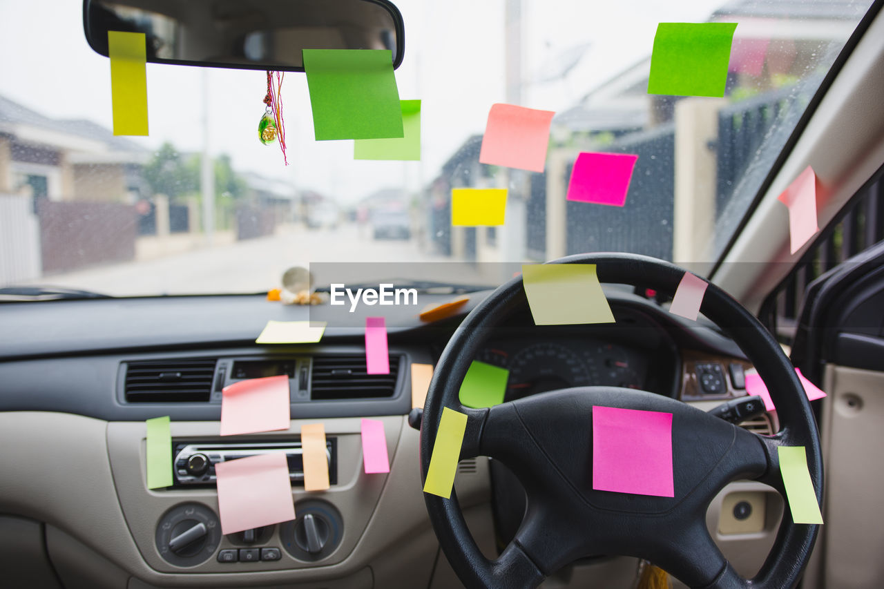 Close-up of blank adhesive notes in car