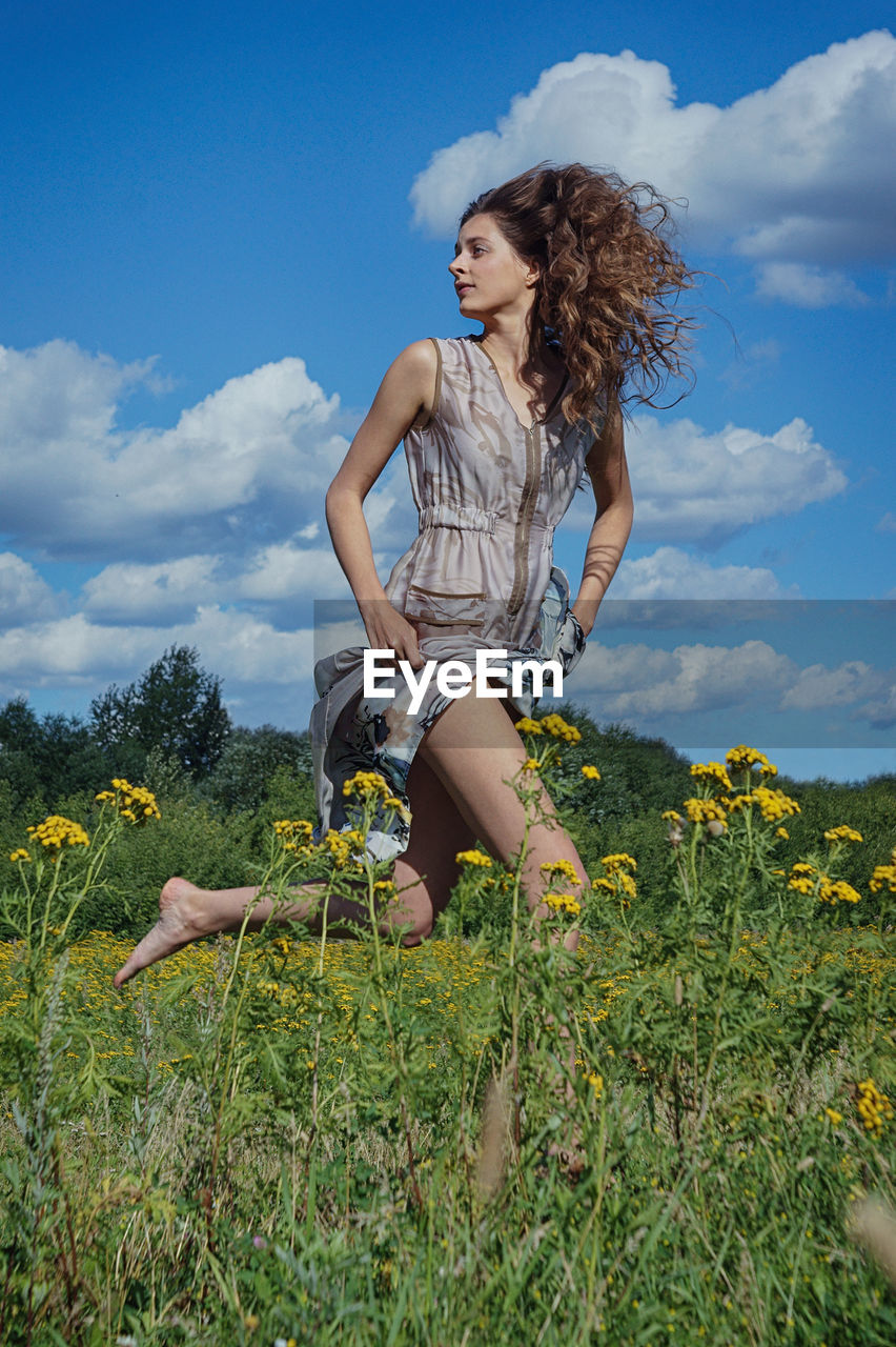 plant, one person, nature, young adult, leisure activity, sky, full length, field, young women, land, lifestyles, cloud - sky, real people, women, casual clothing, hair, beautiful woman, beauty, hairstyle, outdoors