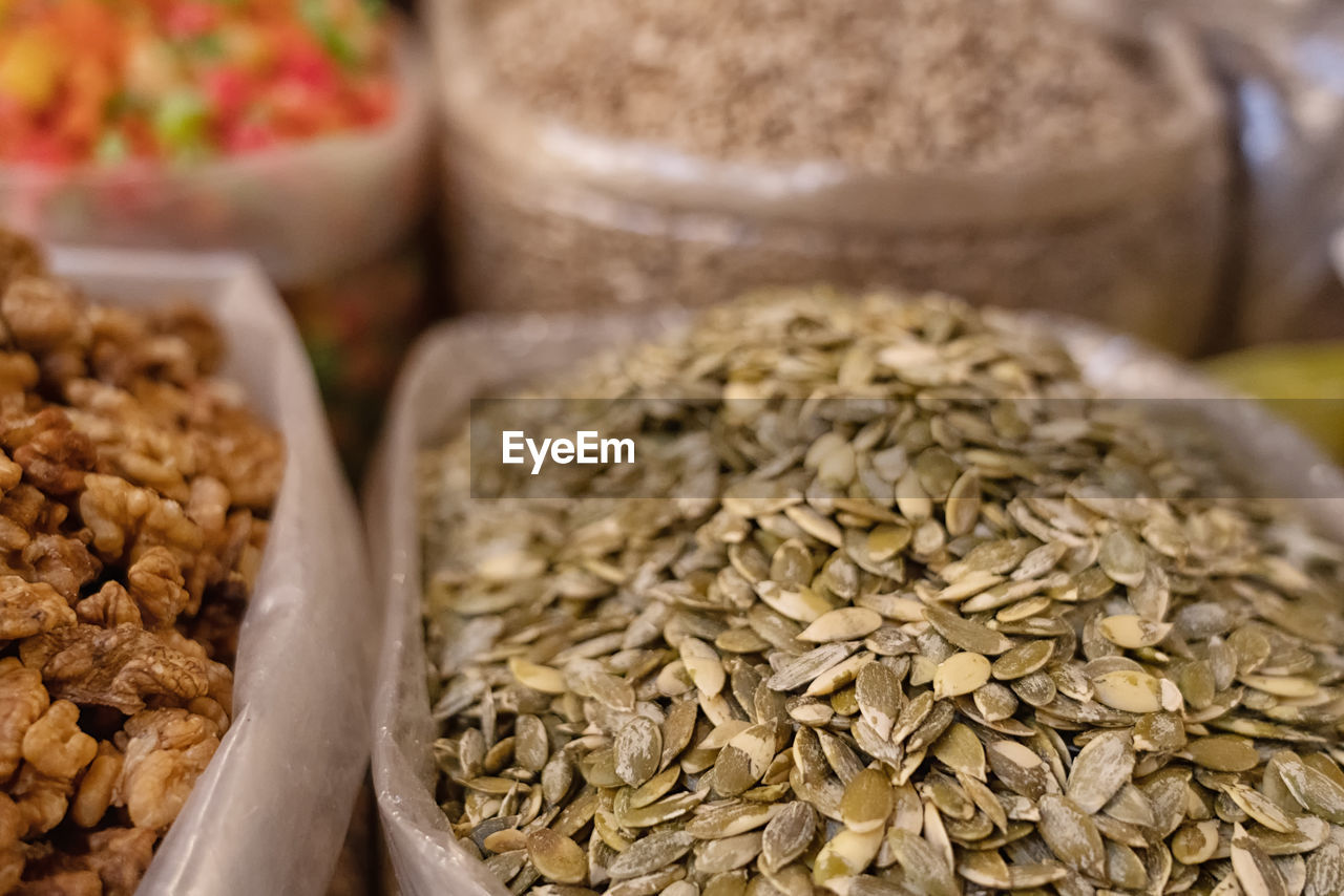 food, food and drink, healthy eating, wellbeing, freshness, still life, close-up, seed, no people, selective focus, indoors, container, choice, variation, market, retail, for sale, dried food, focus on foreground, market stall, breakfast, retail display