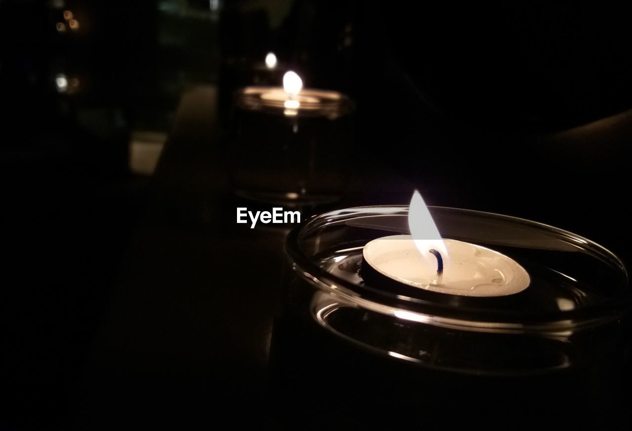 flame, burning, fire, candle, fire - natural phenomenon, heat - temperature, illuminated, dark, indoors, close-up, nature, no people, glowing, darkroom, tea light, light - natural phenomenon, lighting equipment, high angle view, focus on foreground, domestic room, luminosity