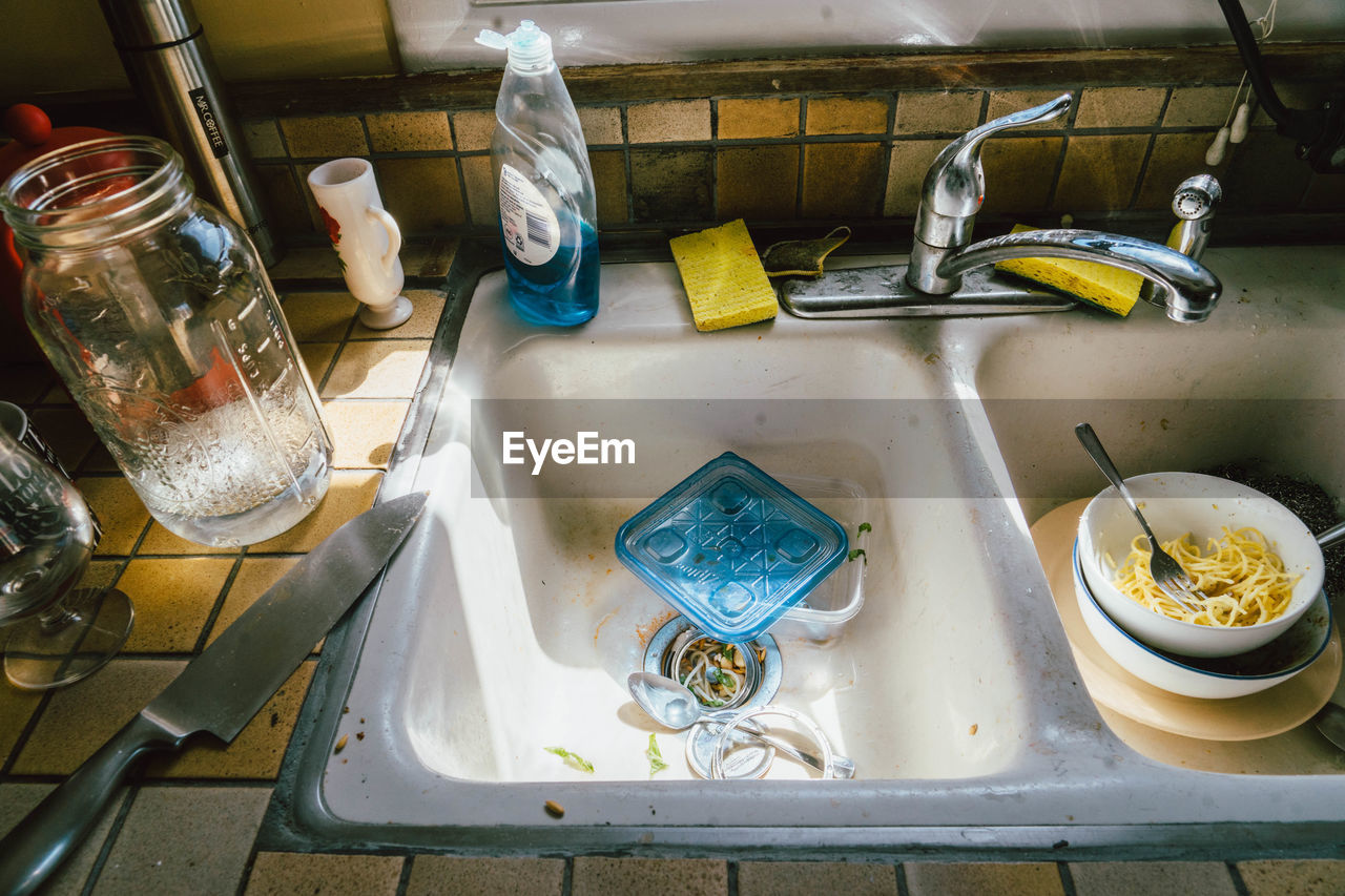 High angle view of messy kitchen sink
