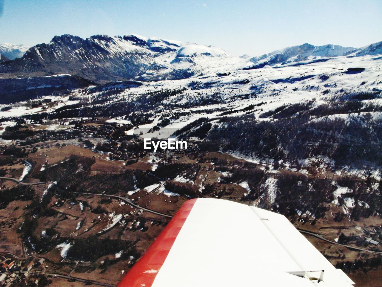 mountain, snow, winter, scenics - nature, cold temperature, beauty in nature, snowcapped mountain, sky, transportation, nature, day, environment, mode of transportation, no people, airplane, mountain range, air vehicle, landscape, flying, outdoors, mountain peak
