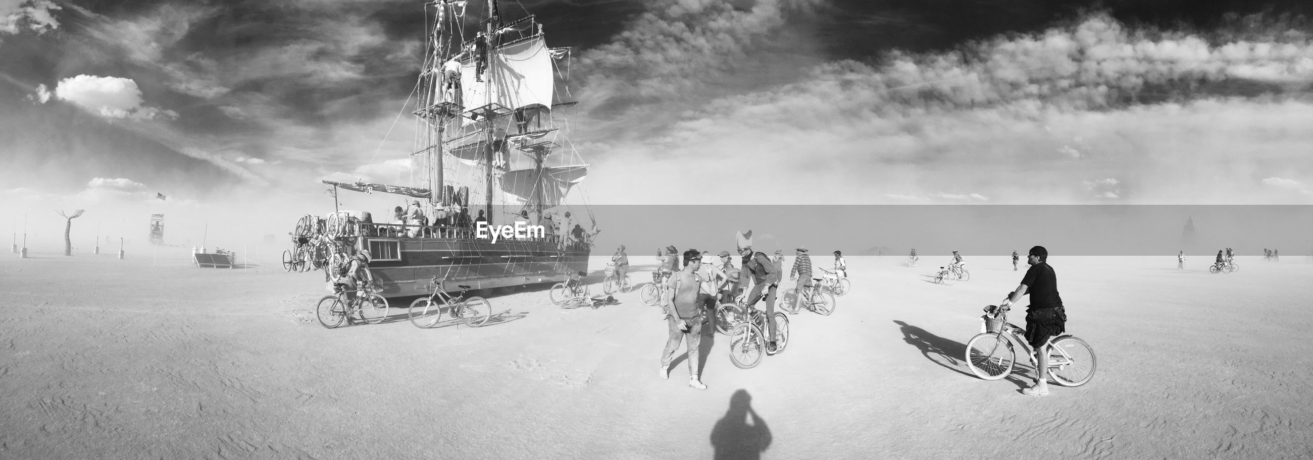 lifestyles, leisure activity, men, sky, person, sitting, beach, water, enjoyment, outdoors, day, chair, cloud - sky, relaxation, vacations, casual clothing, sunlight