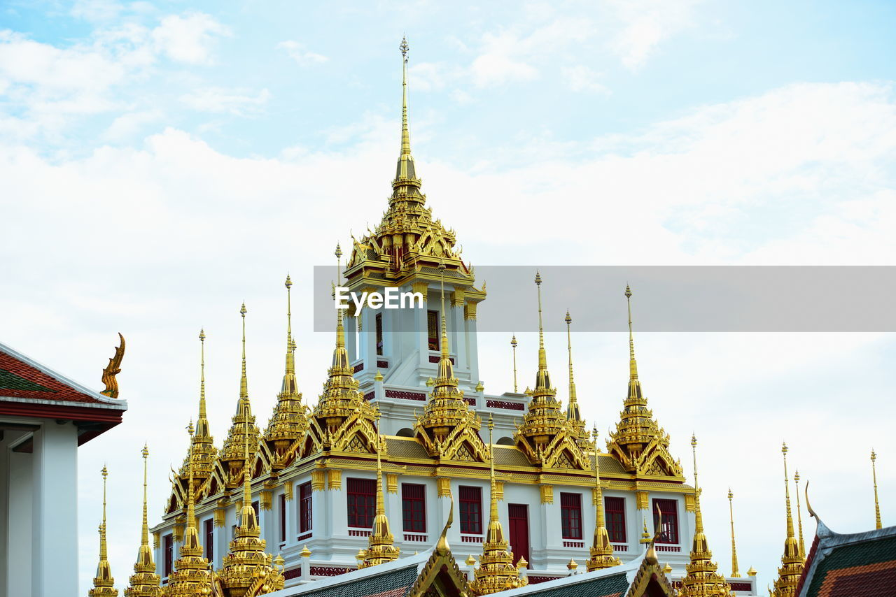 built structure, architecture, building exterior, belief, religion, place of worship, building, spirituality, sky, cloud - sky, gold colored, travel destinations, no people, day, nature, travel, low angle view, spire, outdoors, ornate