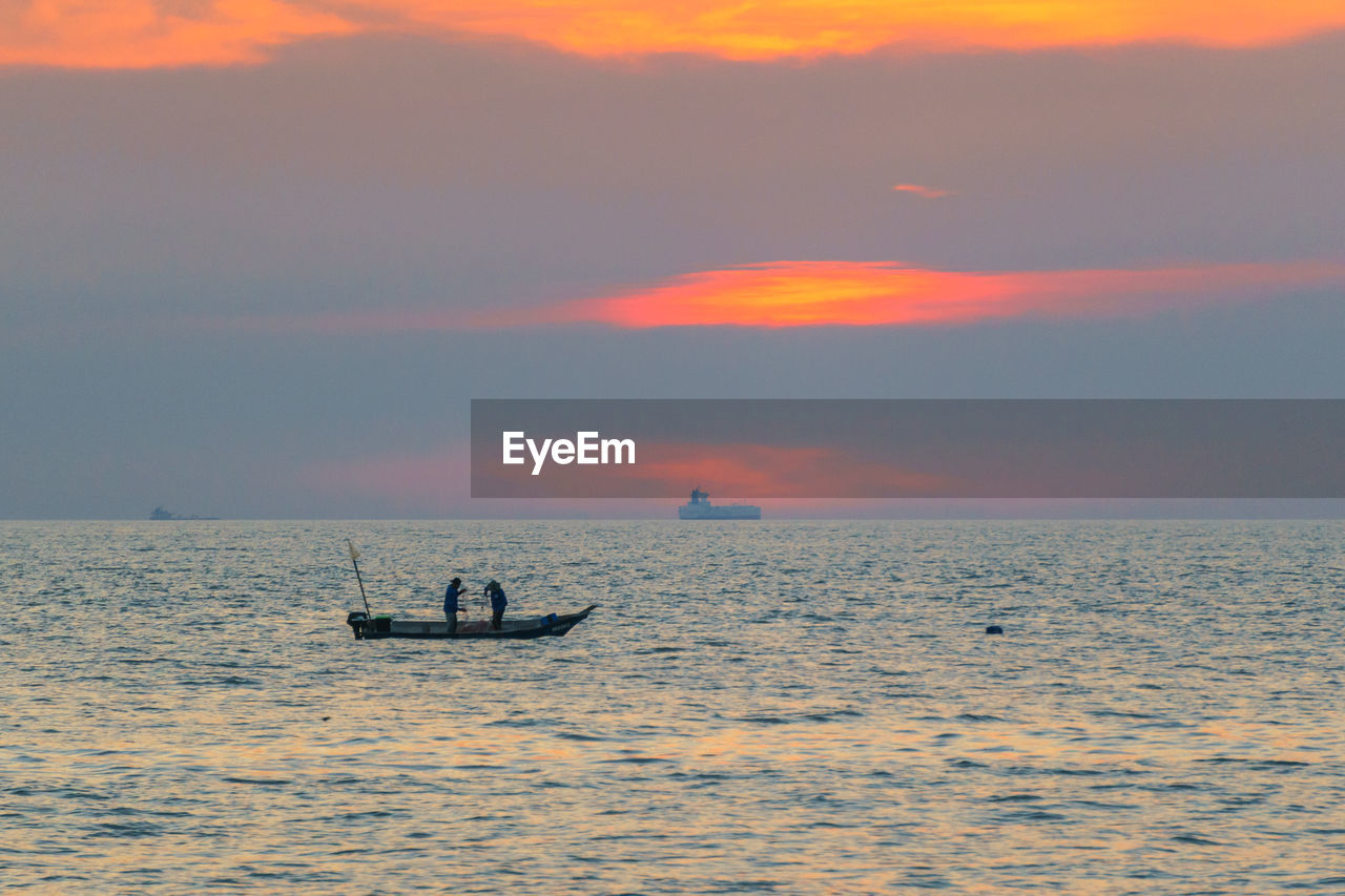sunset, sky, water, sea, beauty in nature, silhouette, nautical vessel, scenics - nature, waterfront, orange color, horizon, transportation, mode of transportation, horizon over water, cloud - sky, real people, nature, men, tranquil scene, outdoors