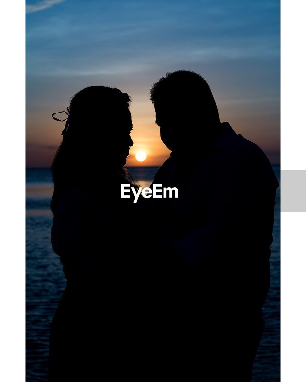 two people, love, togetherness, sunset, silhouette, real people, romance, men, water, bonding, women, couple - relationship, lifestyles, leisure activity, embracing, sky, affectionate, nature, outdoors, standing, beauty in nature, young women, day, human hand, people