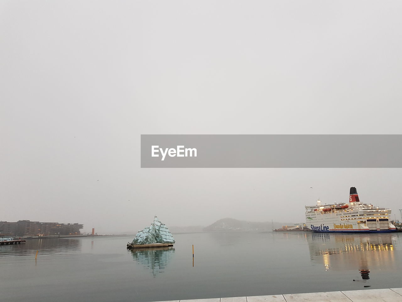 water, nautical vessel, transportation, sky, mode of transportation, waterfront, fog, sea, copy space, no people, nature, travel, day, ship, beauty in nature, architecture, outdoors, passenger craft, cruise ship