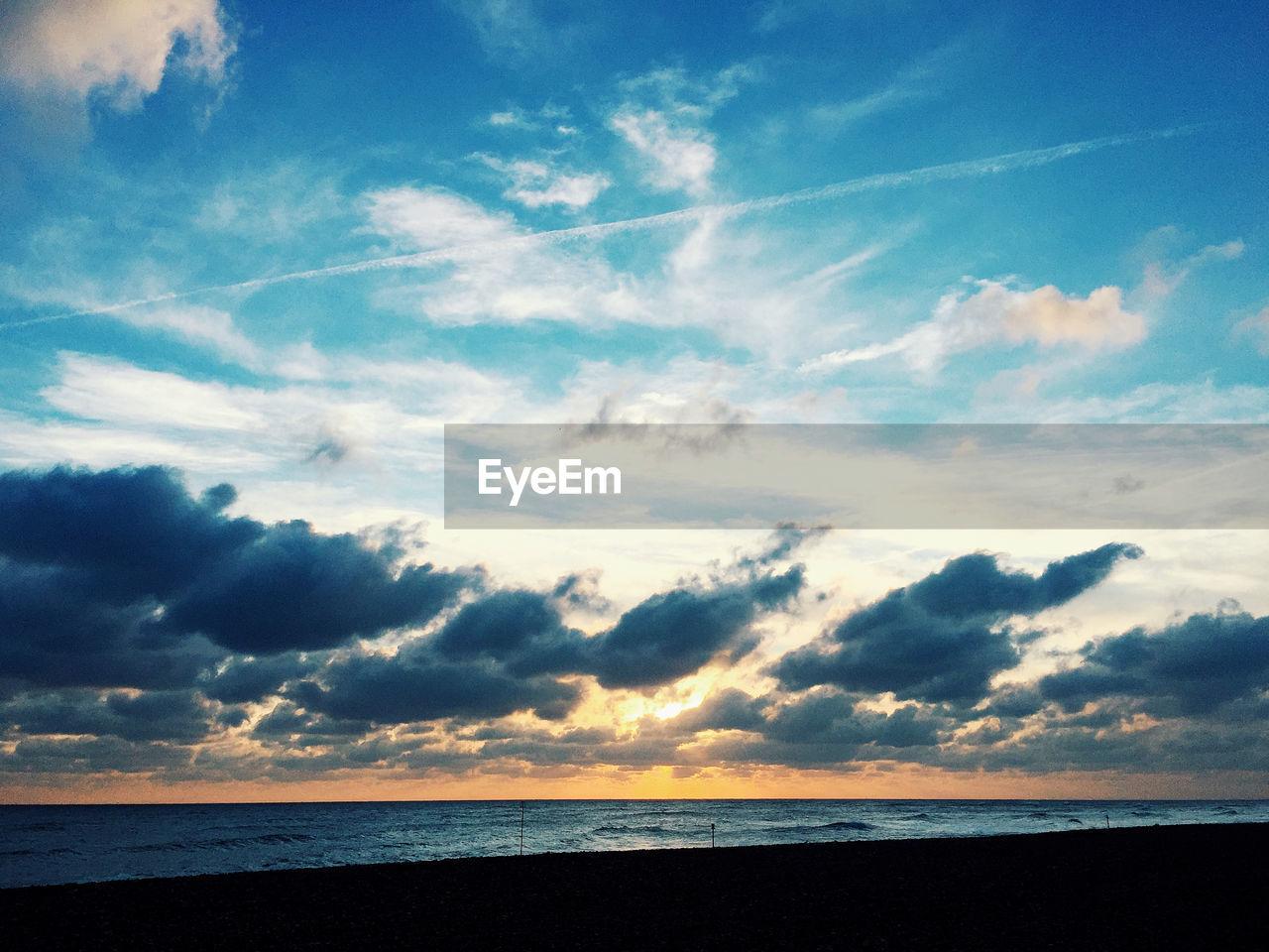 sky, cloud - sky, beauty in nature, horizon, sea, scenics - nature, horizon over water, tranquility, tranquil scene, water, land, nature, beach, sunset, no people, outdoors, idyllic, blue, non-urban scene
