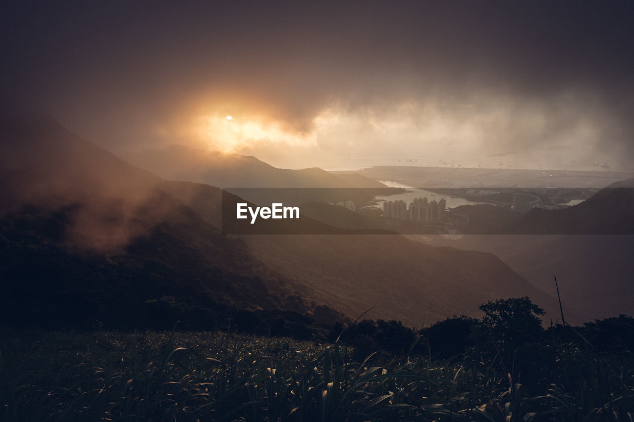 mountain, beauty in nature, scenics - nature, sky, tranquil scene, tranquility, environment, mountain range, landscape, nature, no people, non-urban scene, plant, land, cloud - sky, idyllic, fog, outdoors, sunset, mountain peak