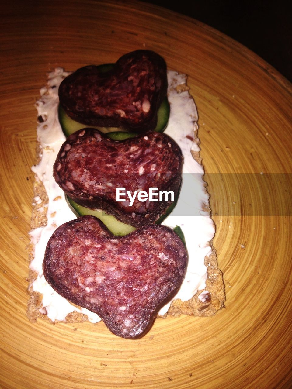 Close-Up Of Salami Sandwich On Wooden Table