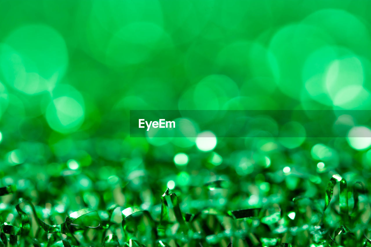 green color, selective focus, no people, close-up, backgrounds, wet, defocused, full frame, drop, water, plant, abstract, lens flare, grass, nature, pattern, outdoors, macro, shiny, dew, purity, blade of grass