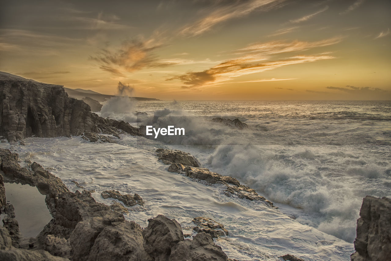 beauty in nature, nature, sunset, scenics, water, sea, sky, wave, motion, idyllic, no people, tranquil scene, outdoors, power in nature, cloud - sky, tranquility, horizon over water, day