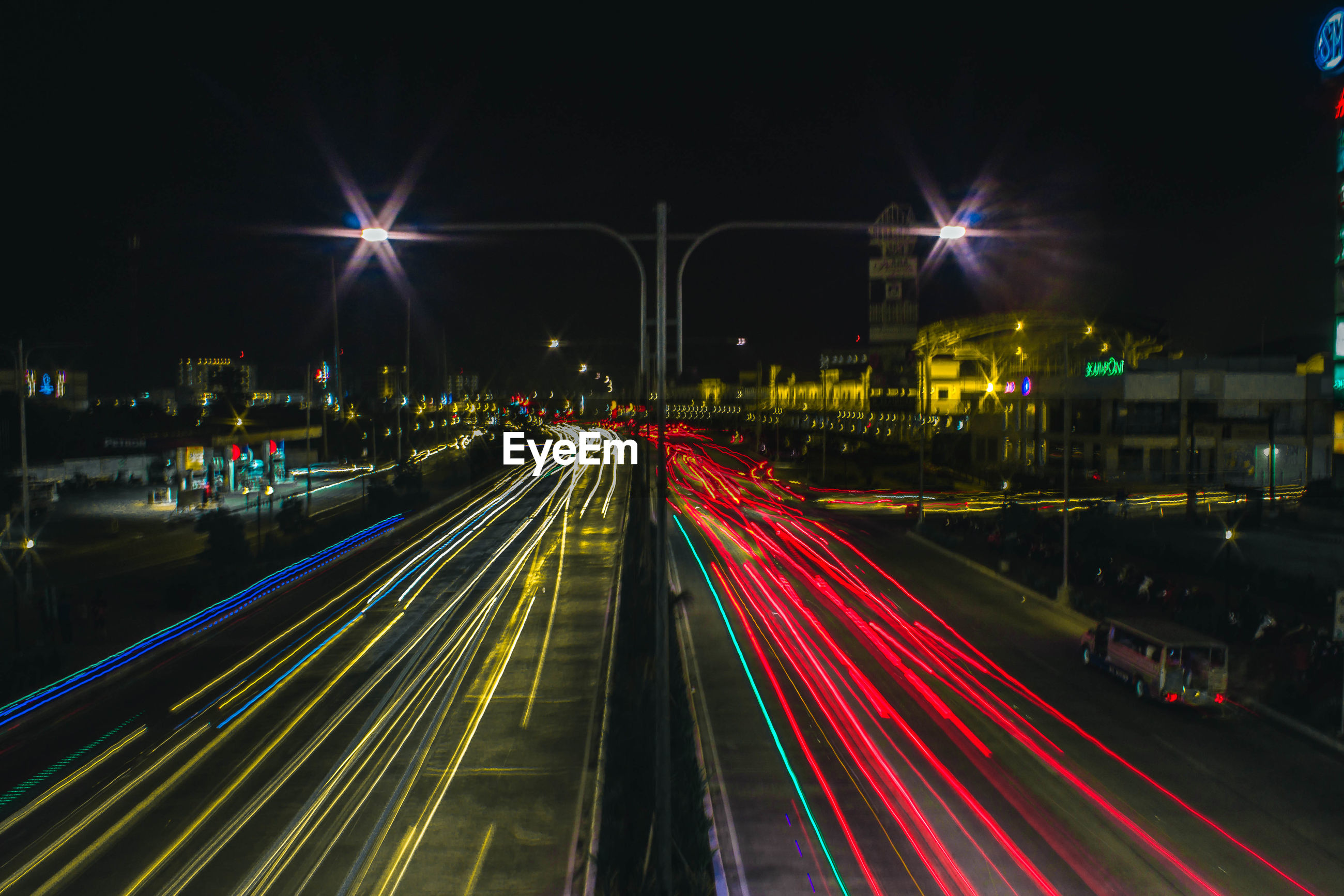 High angle view of light trails on city street at night