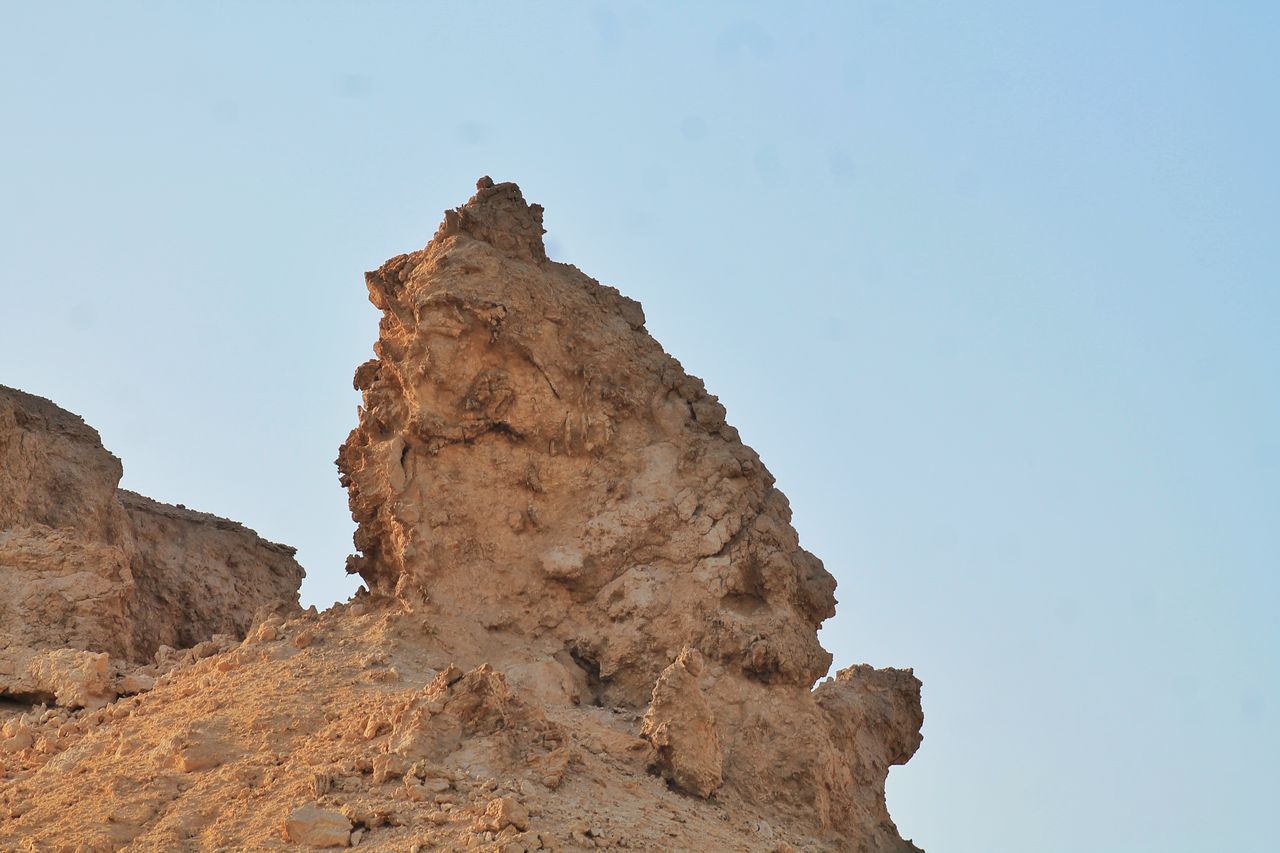 sky, rock, rock formation, rock - object, low angle view, solid, tranquility, clear sky, nature, geology, beauty in nature, tranquil scene, no people, physical geography, mountain, blue, day, scenics - nature, non-urban scene, land, formation, outdoors, eroded, arid climate, mountain peak