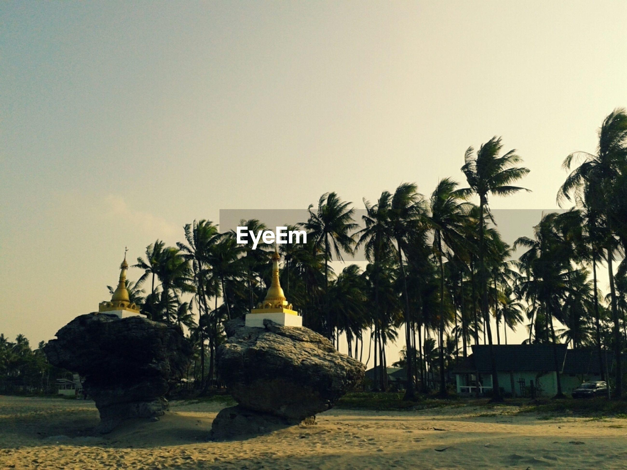 Pagodas on ngwe saung beach against sky