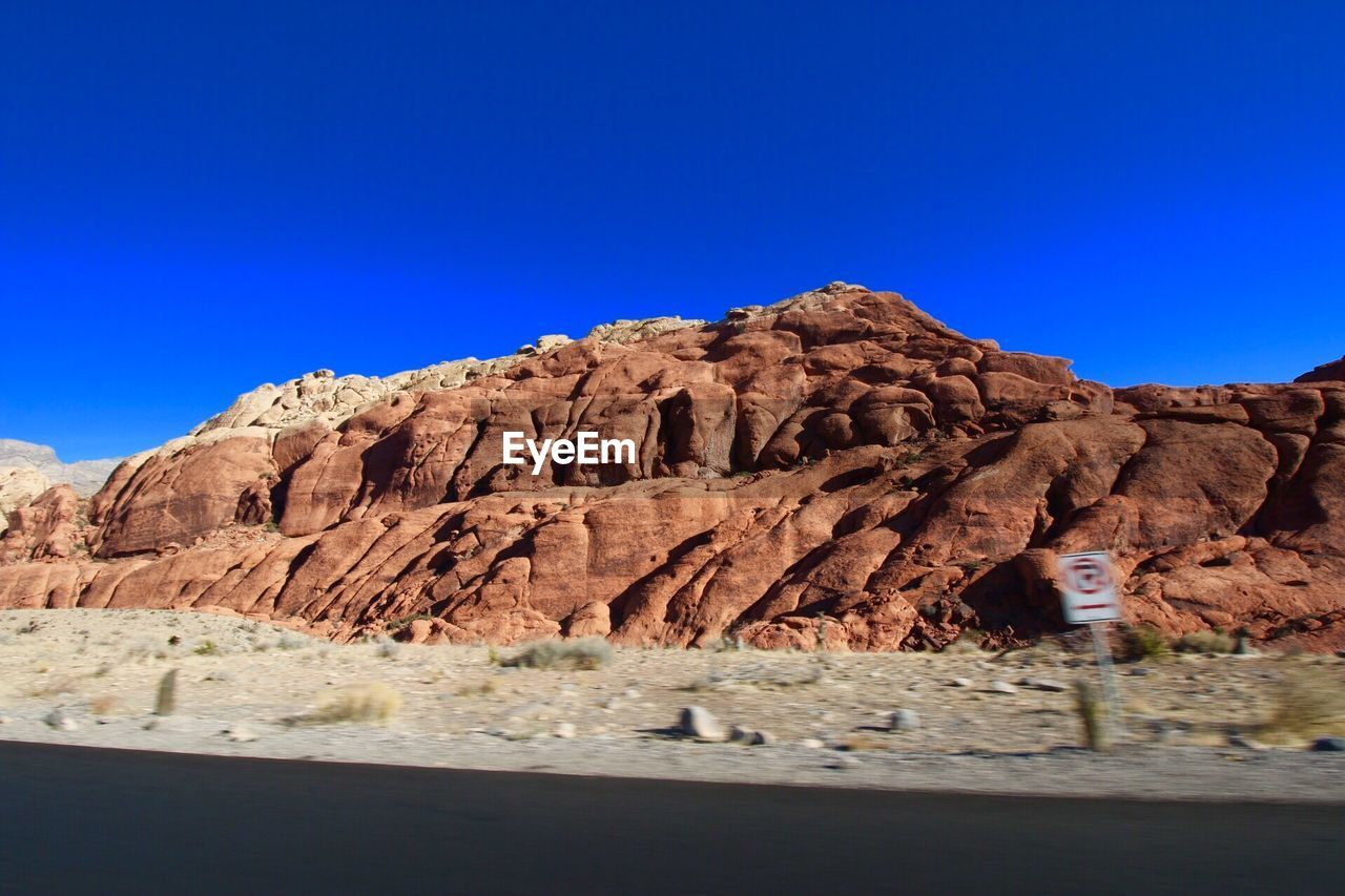 rock formation, rock - object, nature, geology, blue, clear sky, tranquility, arid climate, tranquil scene, mountain, scenics, beauty in nature, desert, no people, physical geography, day, landscape, outdoors, sky