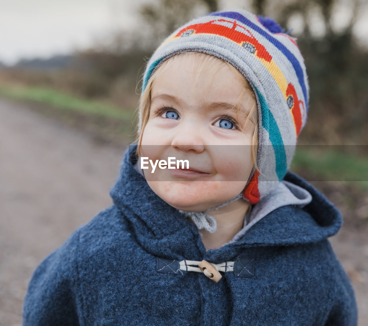 portrait, headshot, clothing, child, one person, focus on foreground, childhood, real people, front view, looking at camera, innocence, day, winter, warm clothing, close-up, boys, men, cute, outdoors, hood - clothing