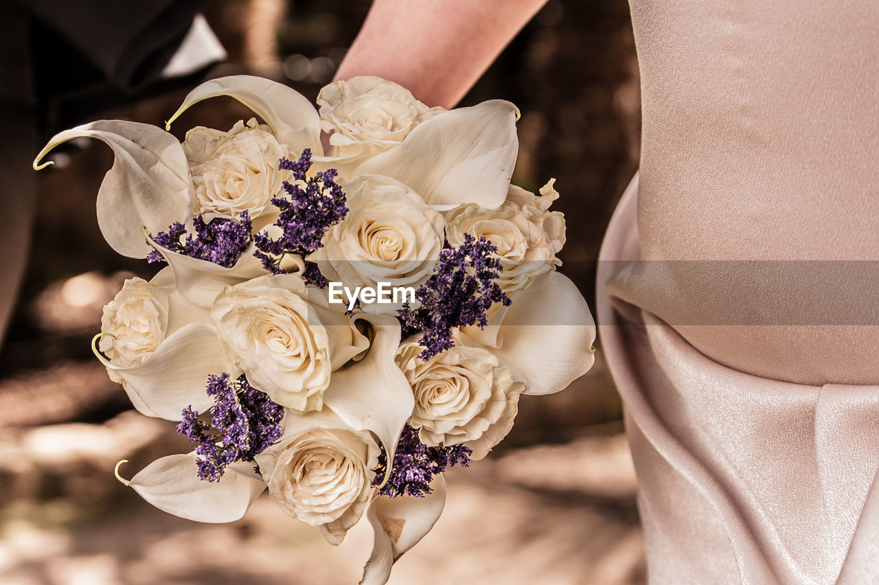 flowering plant, flower, plant, midsection, rose, bouquet, rose - flower, real people, adult, women, holding, flower arrangement, beauty in nature, one person, life events, wedding, freshness, close-up, focus on foreground, celebration, hand, flower head, wedding ceremony