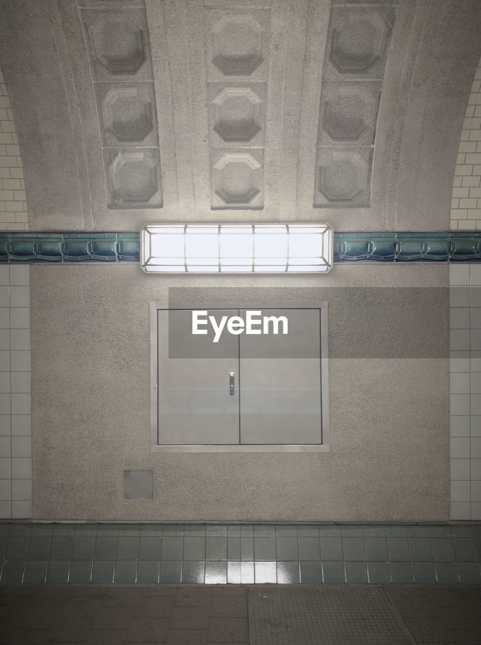 indoors, architecture, built structure, no people, illuminated, flooring, wall - building feature, railing, building, tile, wall, window, safety, entrance, absence, lighting equipment, empty, white, subway, protection, ceiling