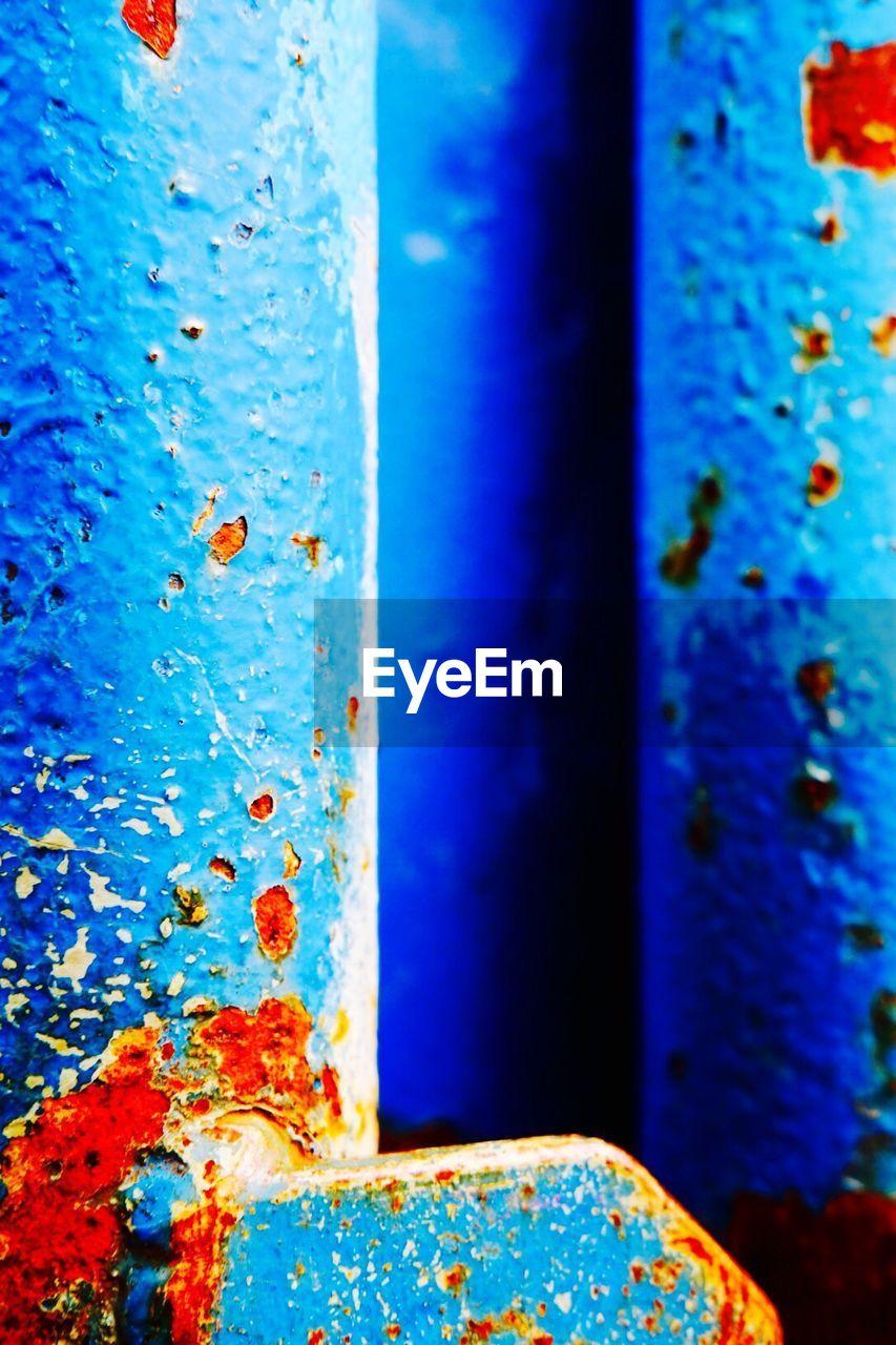 Close-up of blue rusty metal