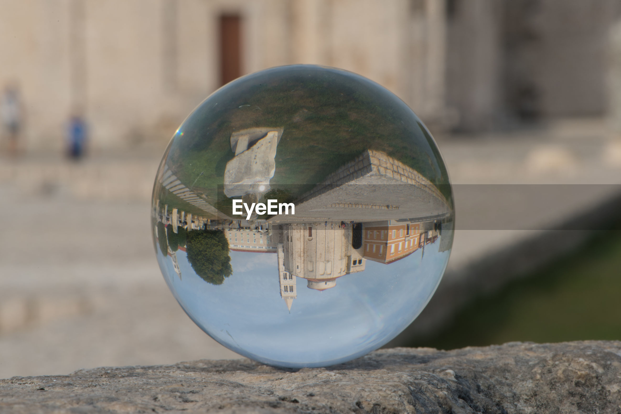 CLOSE-UP OF CRYSTAL BALL ON GLASS OF STONE