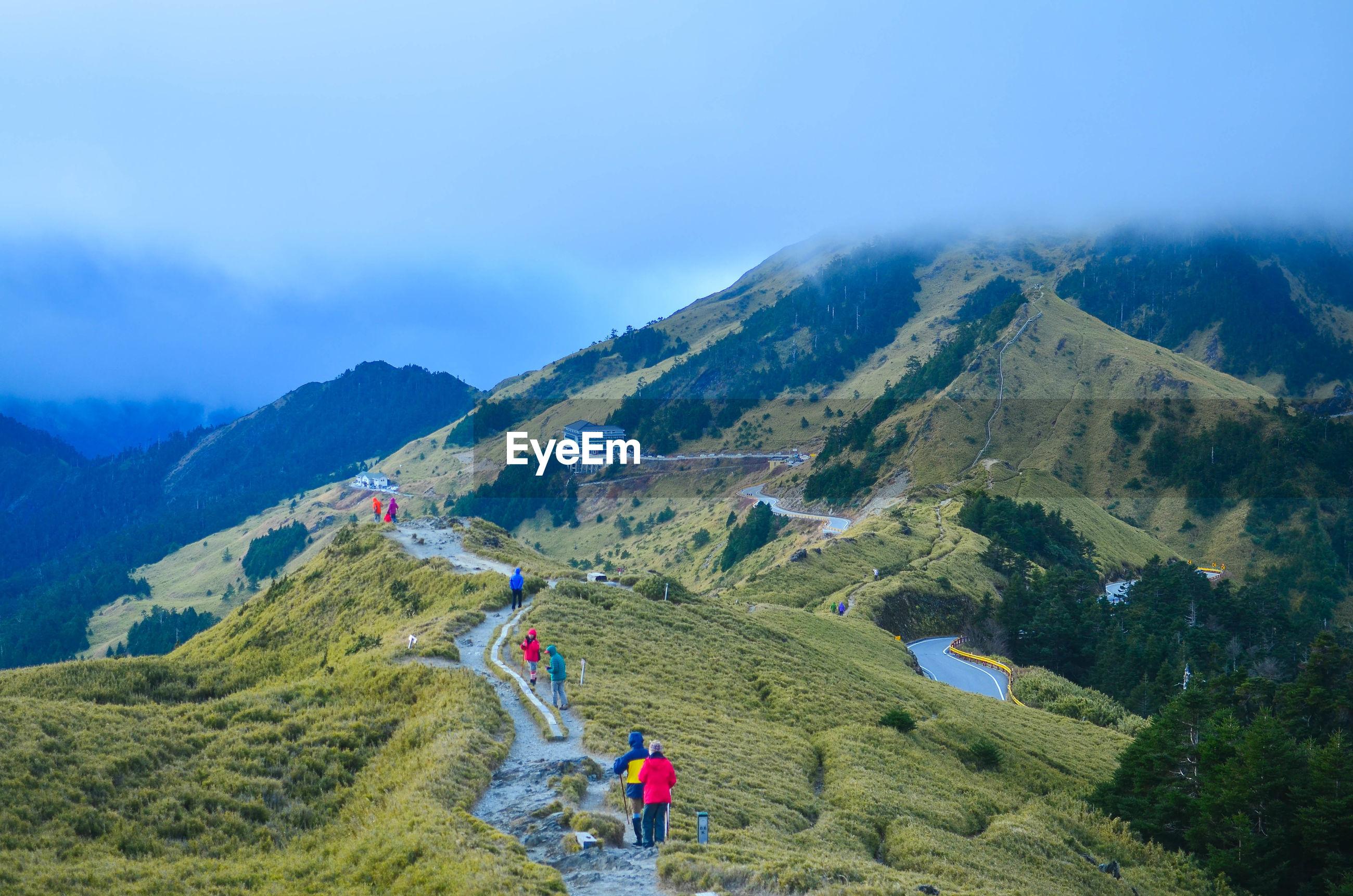 People walking on track on mountain