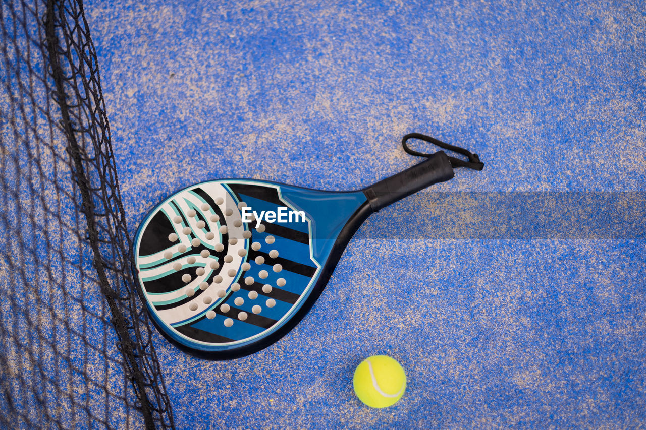 Close up padel or tennis racket and balls
