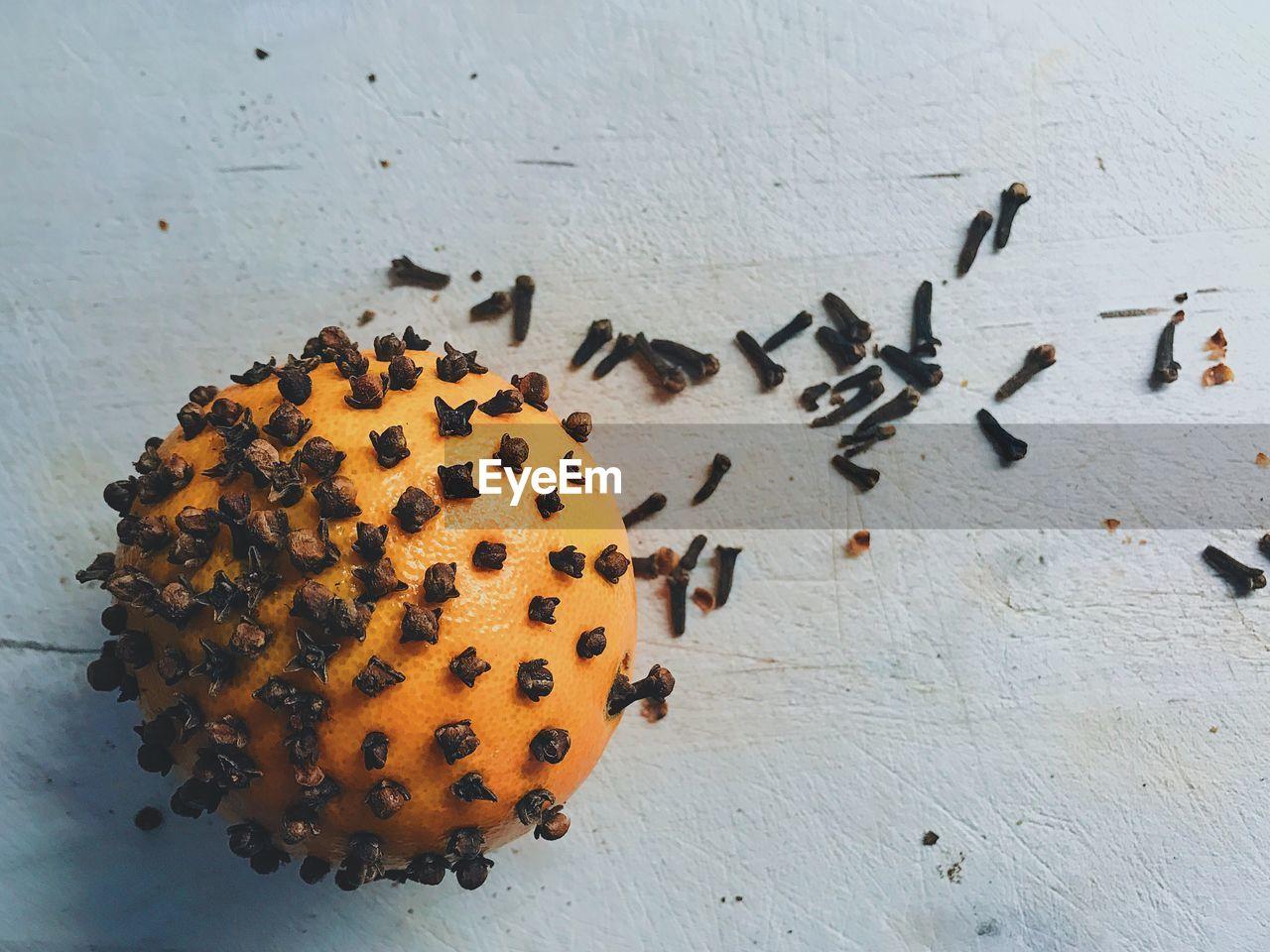 Close-Up Of Cloves On Orange