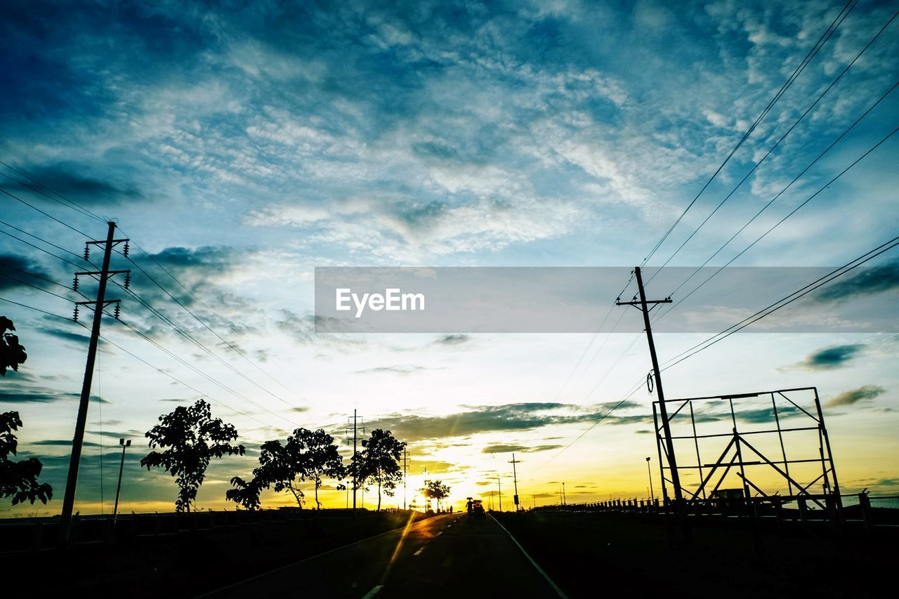 cable, electricity pylon, sky, cloud - sky, power line, electricity, connection, silhouette, power supply, no people, transportation, sunset, nature, telephone line, road, day, outdoors, beauty in nature, scenics, tree