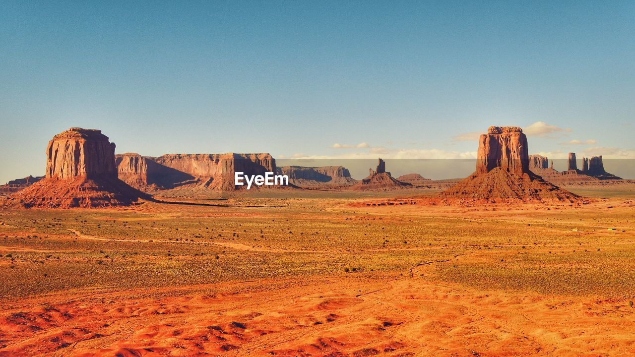 Scenic View Of Landscape With Rock Formations Against Sky At Monument Valley