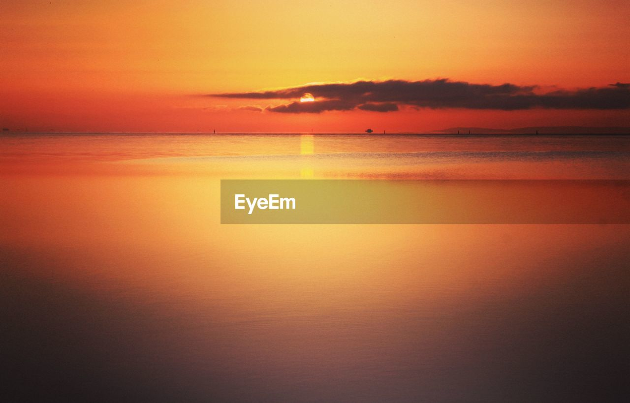 sunset, scenics, beauty in nature, sea, nature, tranquil scene, tranquility, sky, water, silhouette, orange color, reflection, idyllic, no people, outdoors, horizon over water
