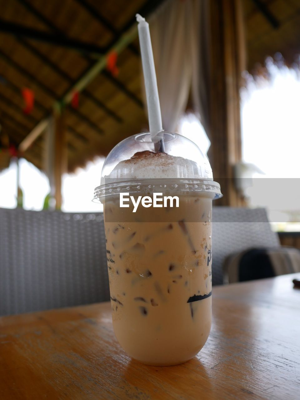 CLOSE-UP OF DRINK ON TABLE AT CAFE