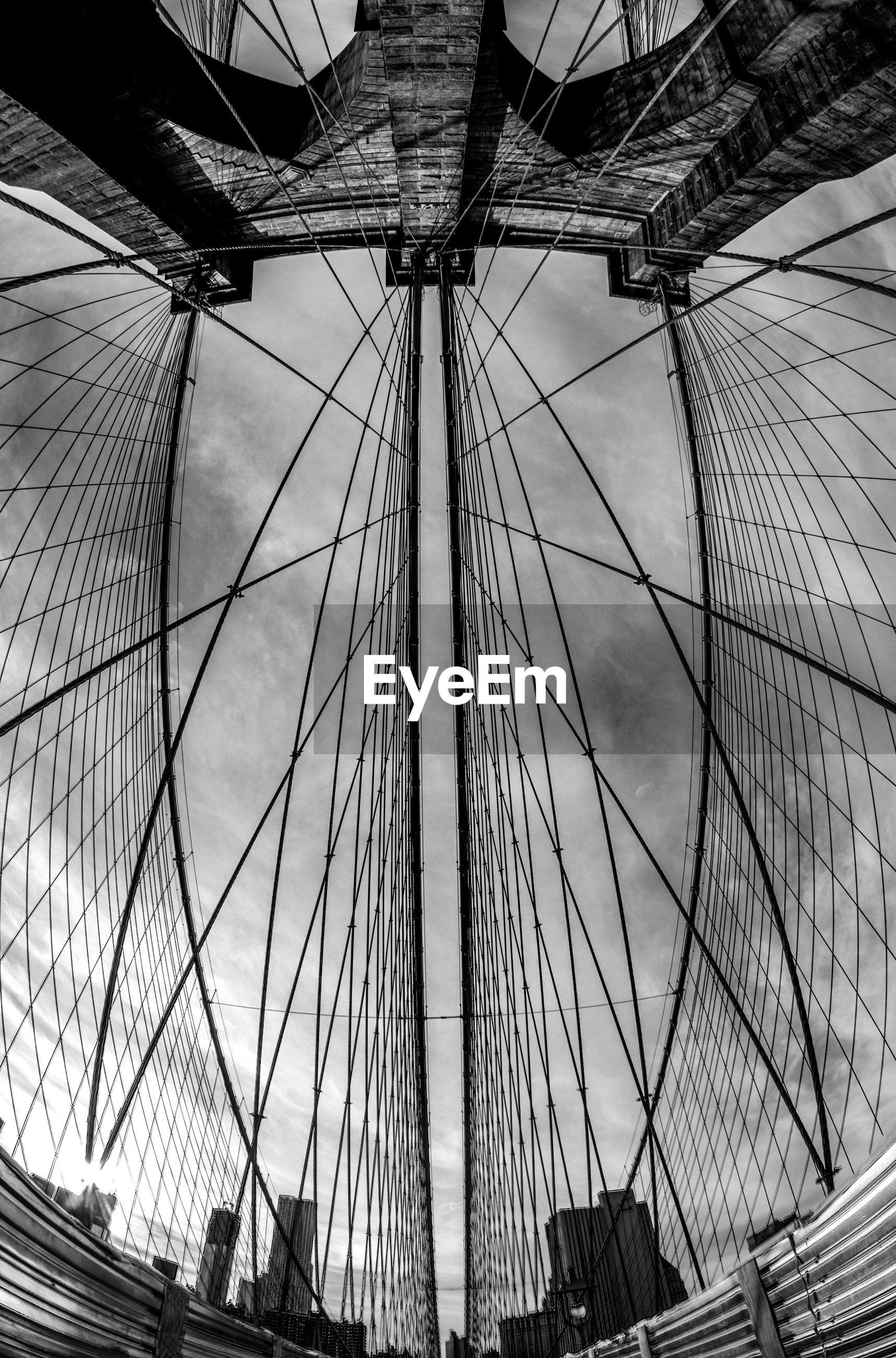 Fish-eye lens of brooklyn bridge against cloudy sky