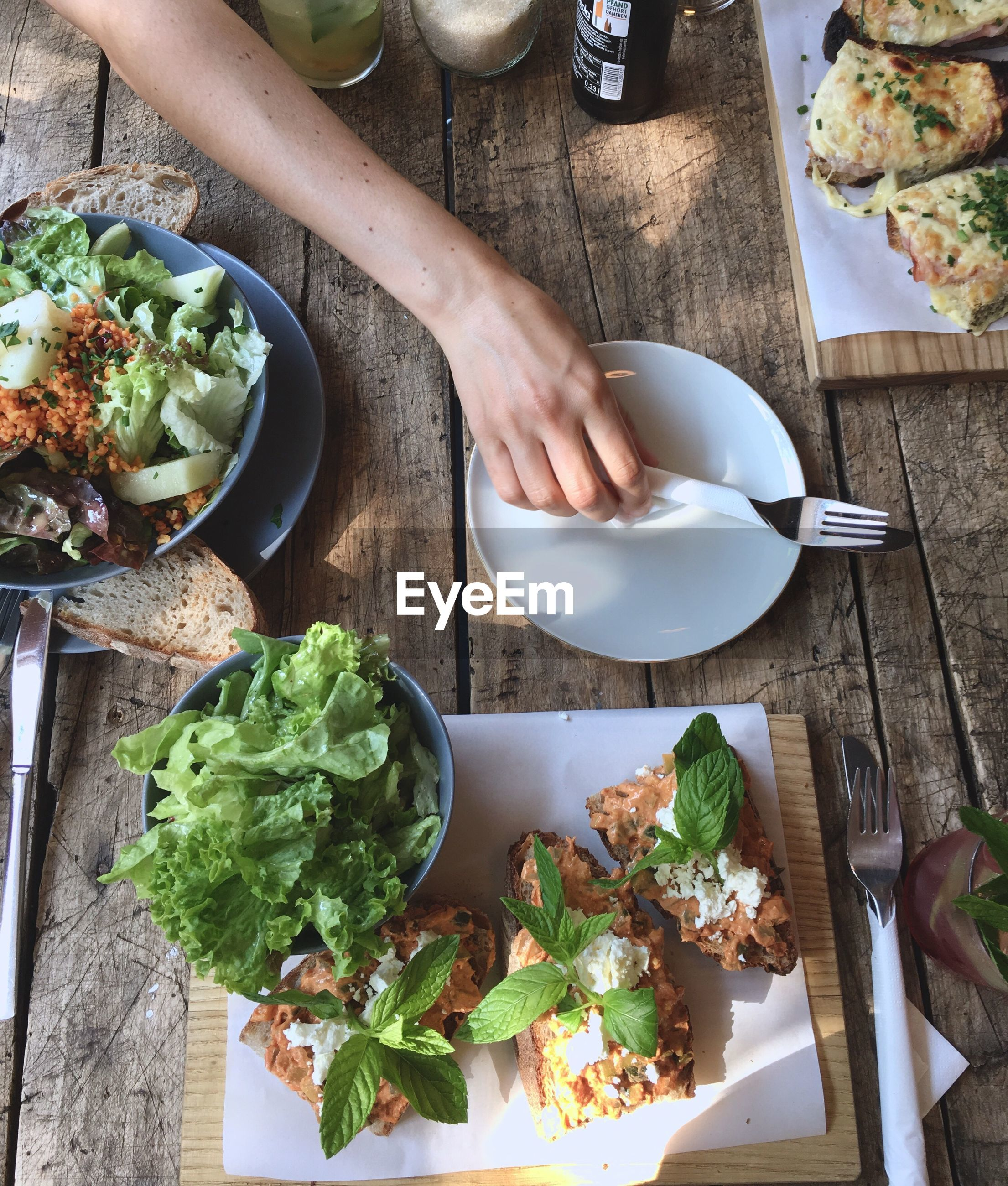 only women, human hand, food and drink, one woman only, one person, adults only, high angle view, vegetable, plate, adult, indoors, human body part, people, salad, women, food, healthy eating, freshness, close-up, day