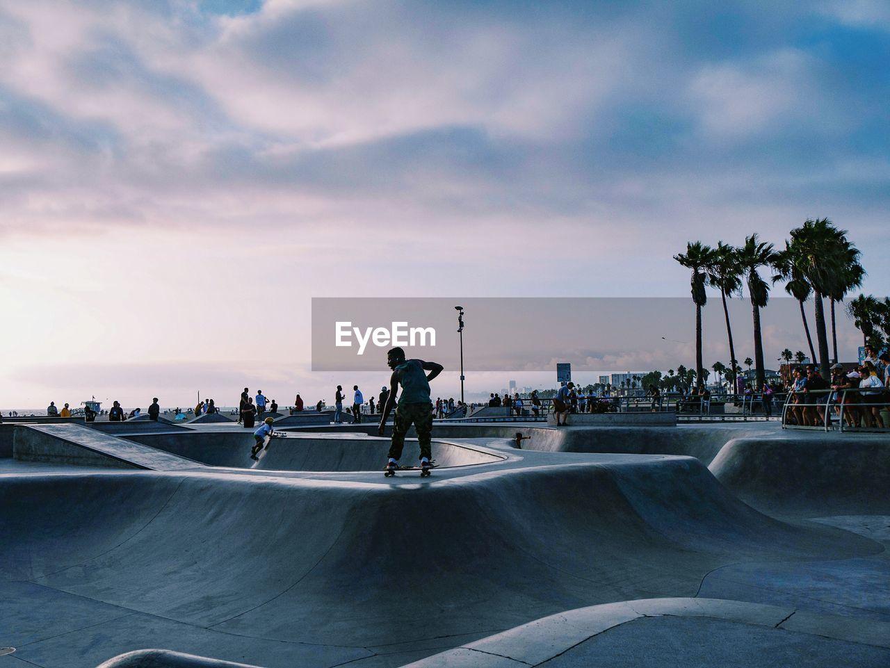 People At Skateboarding Park Against Sky During Sunset