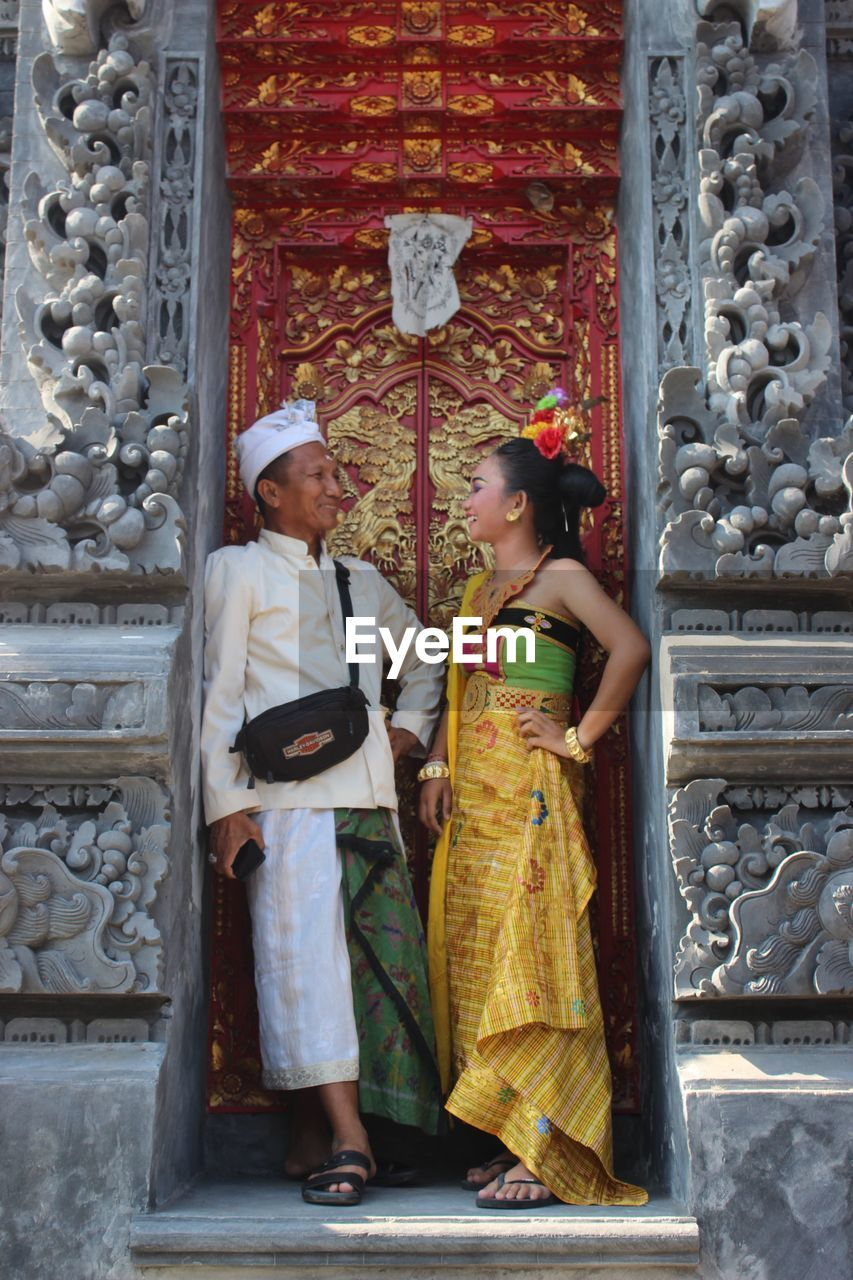 two people, women, real people, standing, clothing, architecture, adult, traditional clothing, people, full length, built structure, rear view, lifestyles, fashion, religion, females, place of worship, building, togetherness, couple - relationship