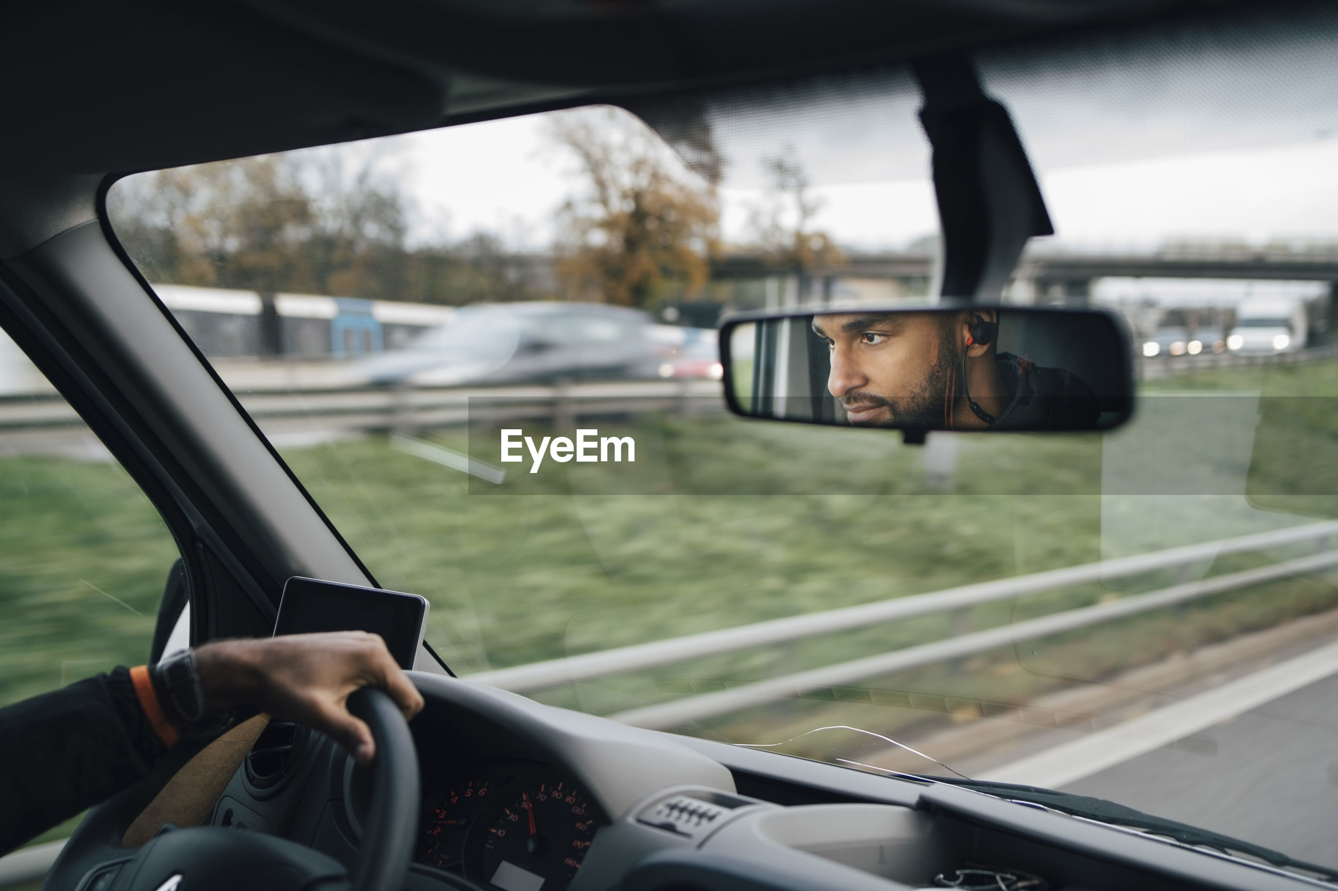 PORTRAIT OF MAN PHOTOGRAPHING THROUGH CAR
