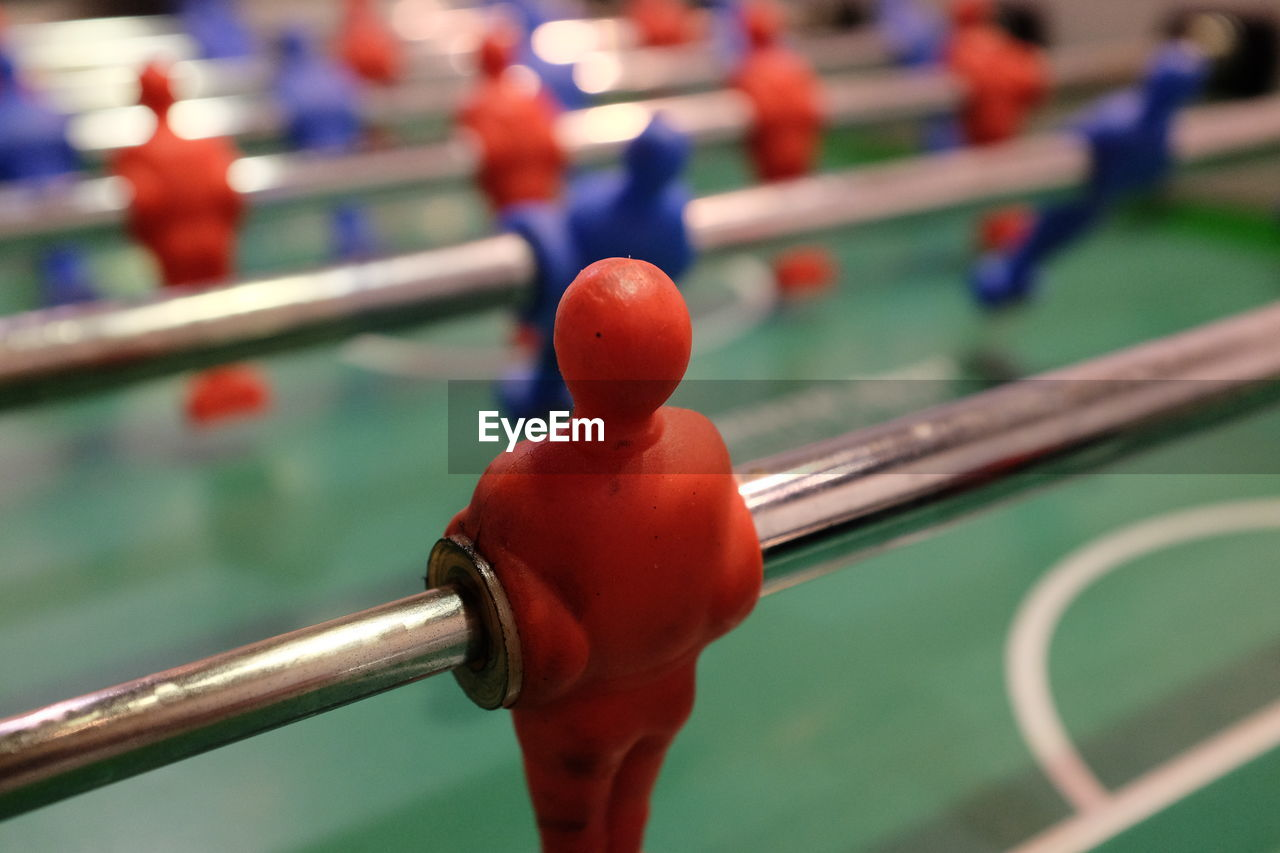 sport, leisure games, human representation, male likeness, competition, figurine, representation, focus on foreground, relaxation, close-up, team sport, no people, soccer, leisure activity, competitive sport, metal, indoors, challenge, toy, high angle view