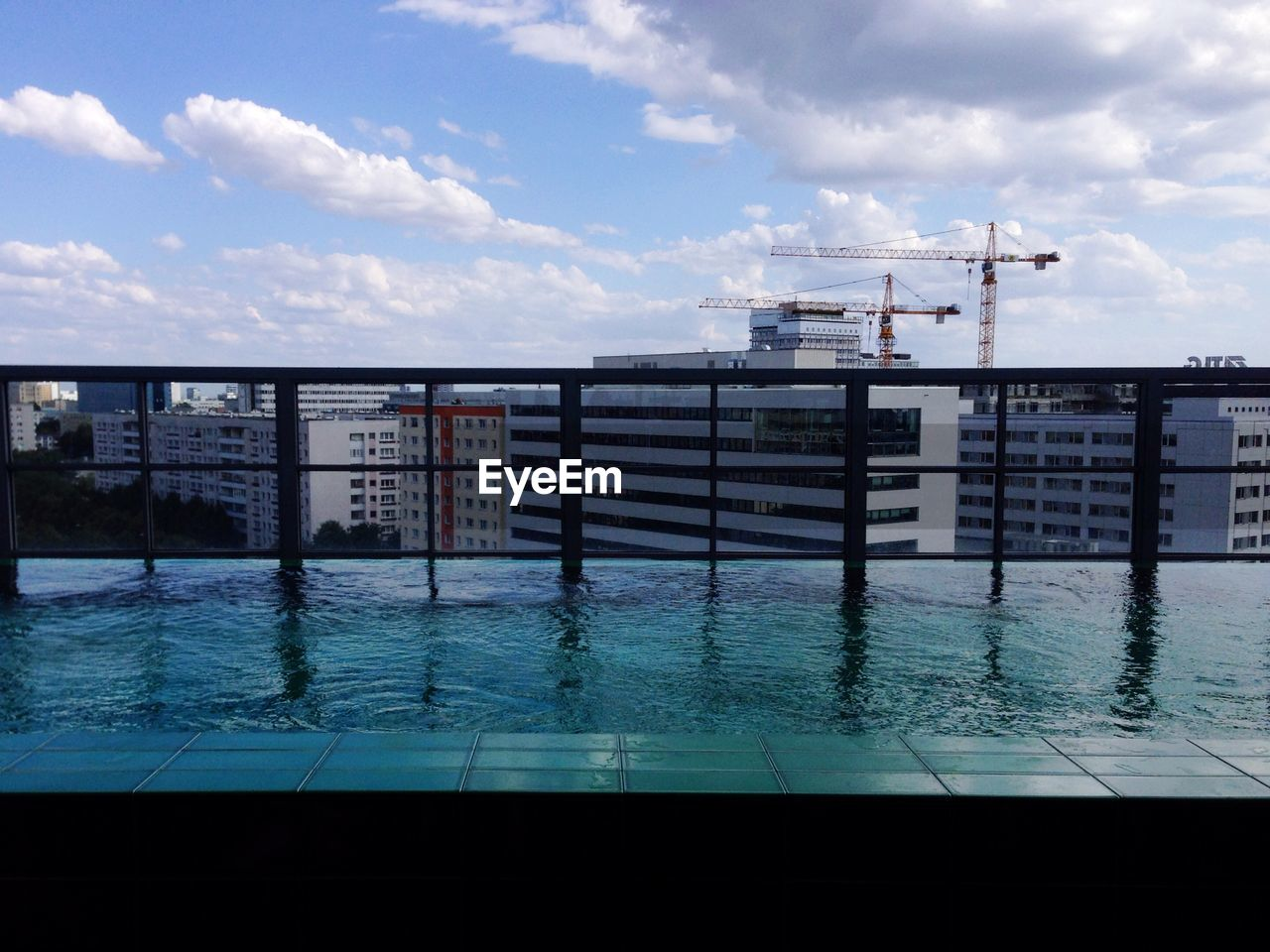 Swimming pool with buildings against the sky