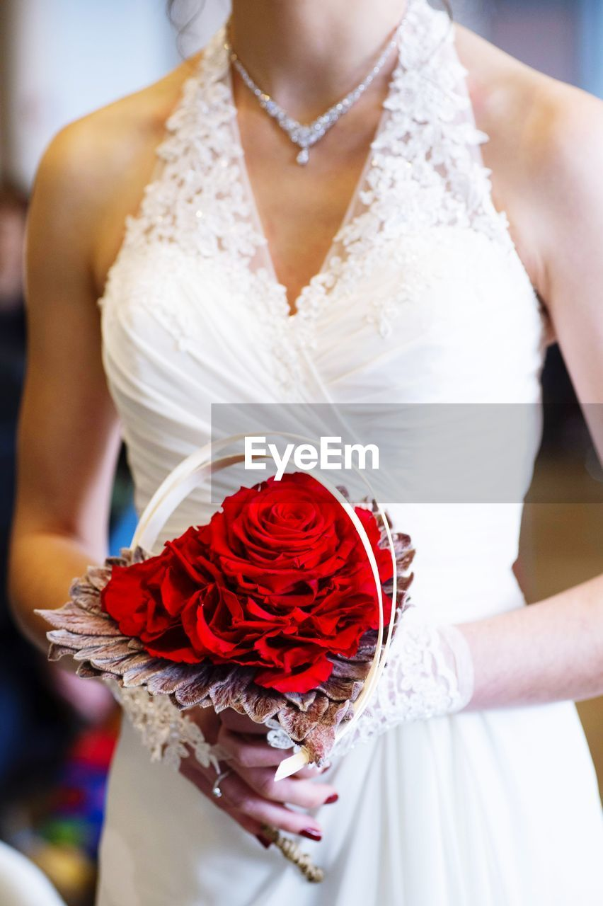 women, one person, midsection, real people, adult, bride, wedding, newlywed, focus on foreground, celebration, holding, event, red, lifestyles, clothing, life events, wedding dress, fashion, hand, wedding ceremony