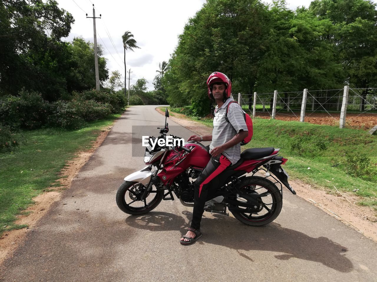 transportation, one person, real people, full length, mode of transportation, tree, road, leisure activity, plant, land vehicle, casual clothing, lifestyles, women, females, nature, helmet, day, ride, riding, outdoors